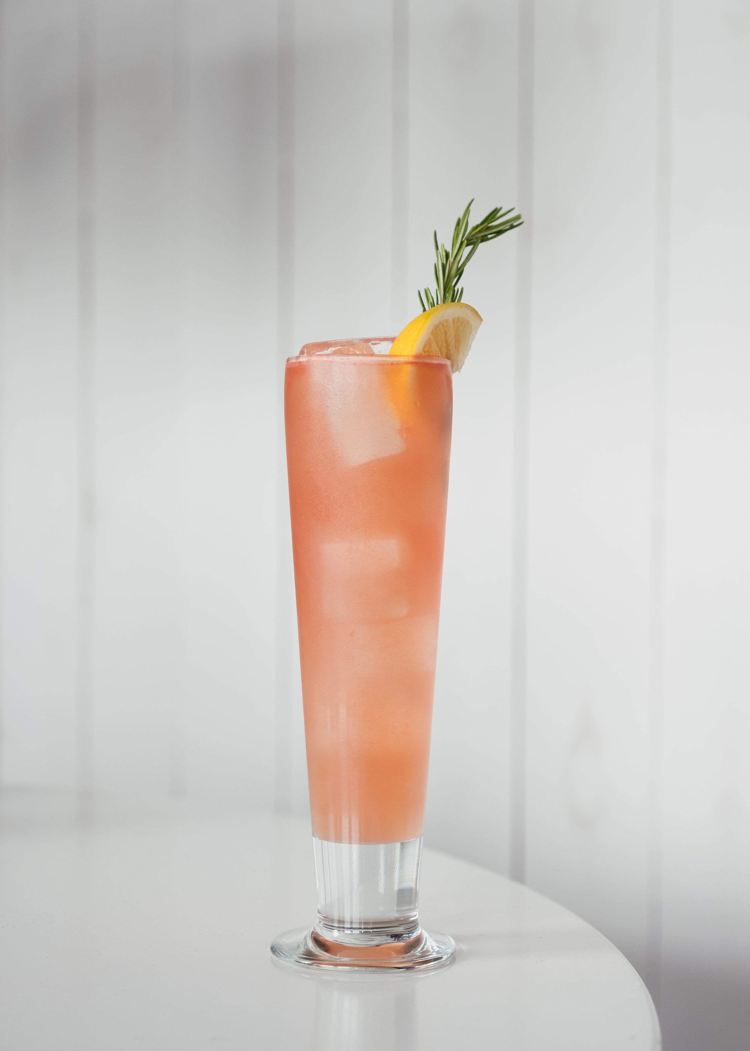 ingredients - 2 oz Citrus-forward gin¾ oz ginger liqueur1 oz fresh lemon juice½ oz *Rosemary simple syrup3-4 one-inch cubes of watermelonDry lemon soda