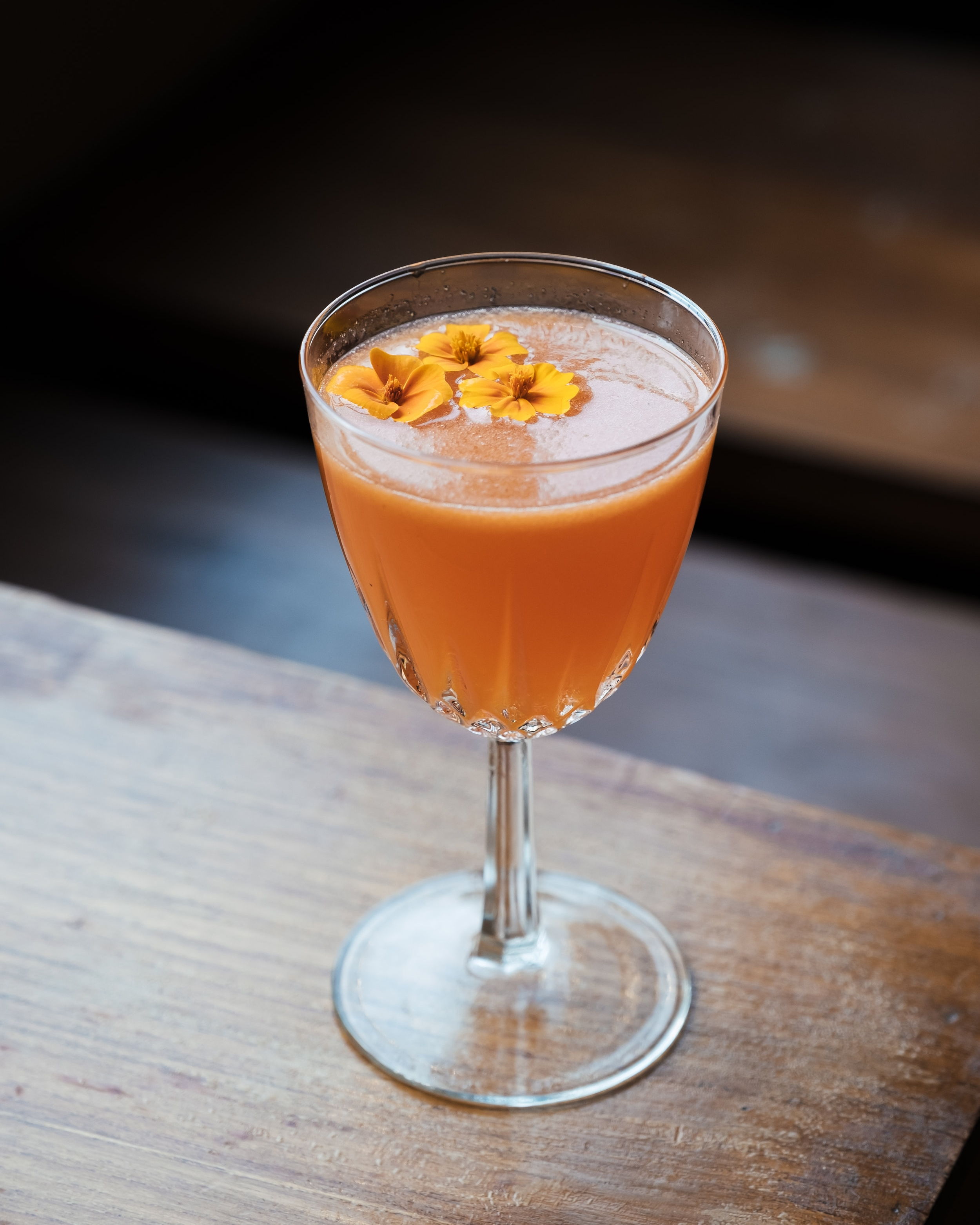 ingredients: - 1 oz. Mezcal Espadín3/4 oz. Aperol3/4 oz. Grapefruit juice1/2 oz. Passionfruit syrup1 dash orange bitters