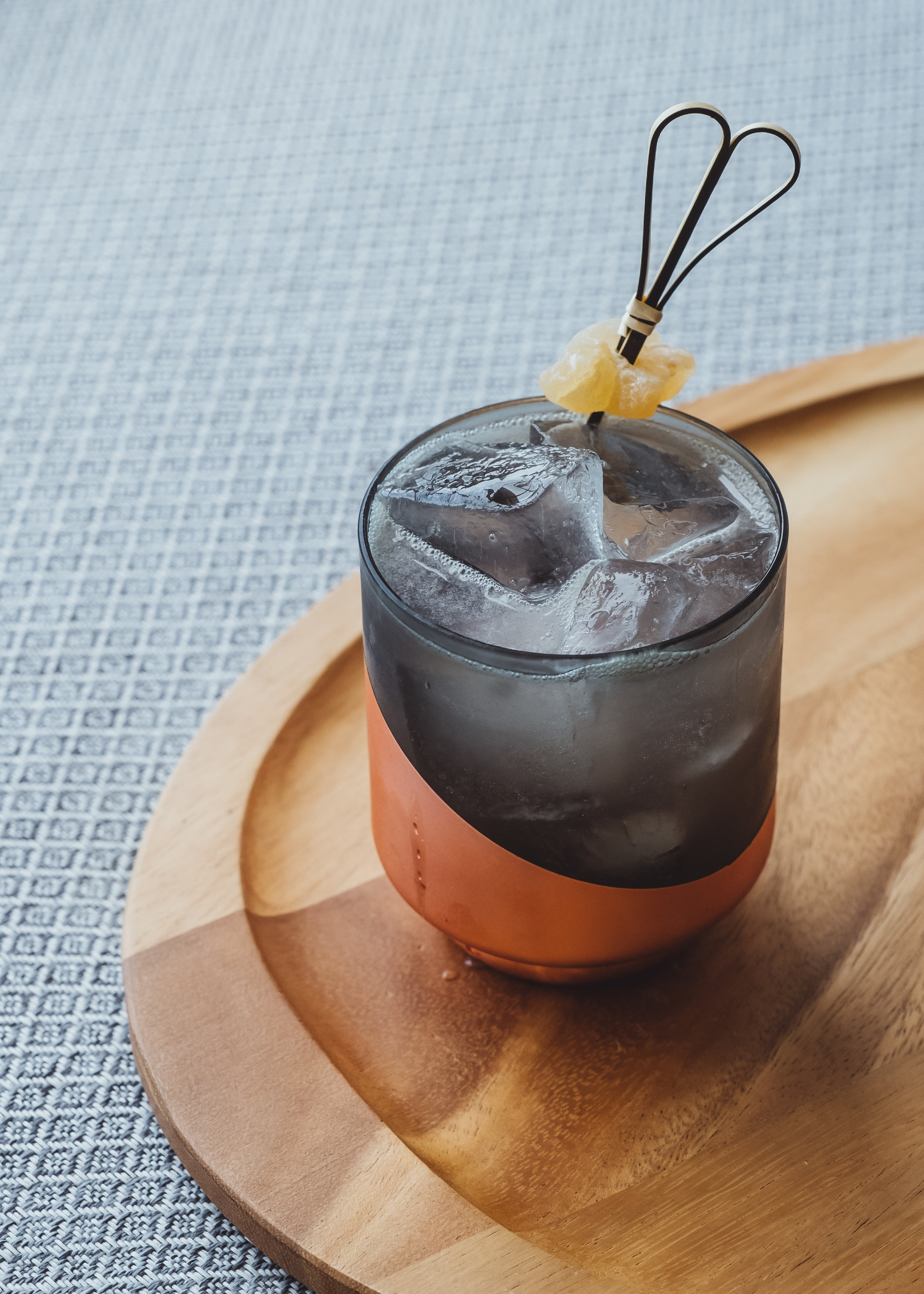 Ingredients: - 1½ oz rice-based Baijiu¾ oz ginger liqueur¾ oz fresh lemon juice½ oz hibiscus-infused rich simple syrup (recipe below)3 dashes Lemongrass-Cardamom bittersTopo Chico