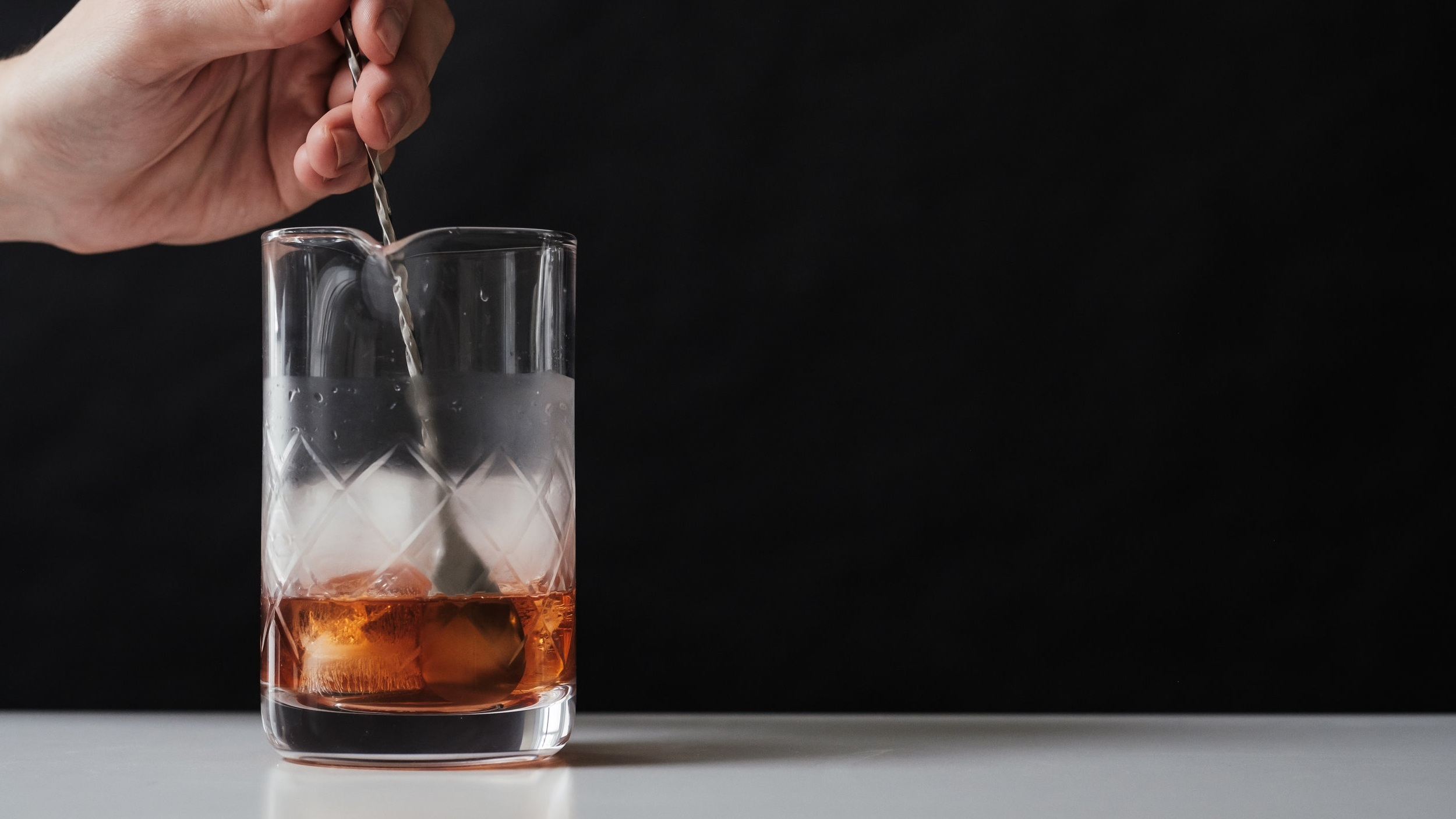 Stir with ice until chilled. -