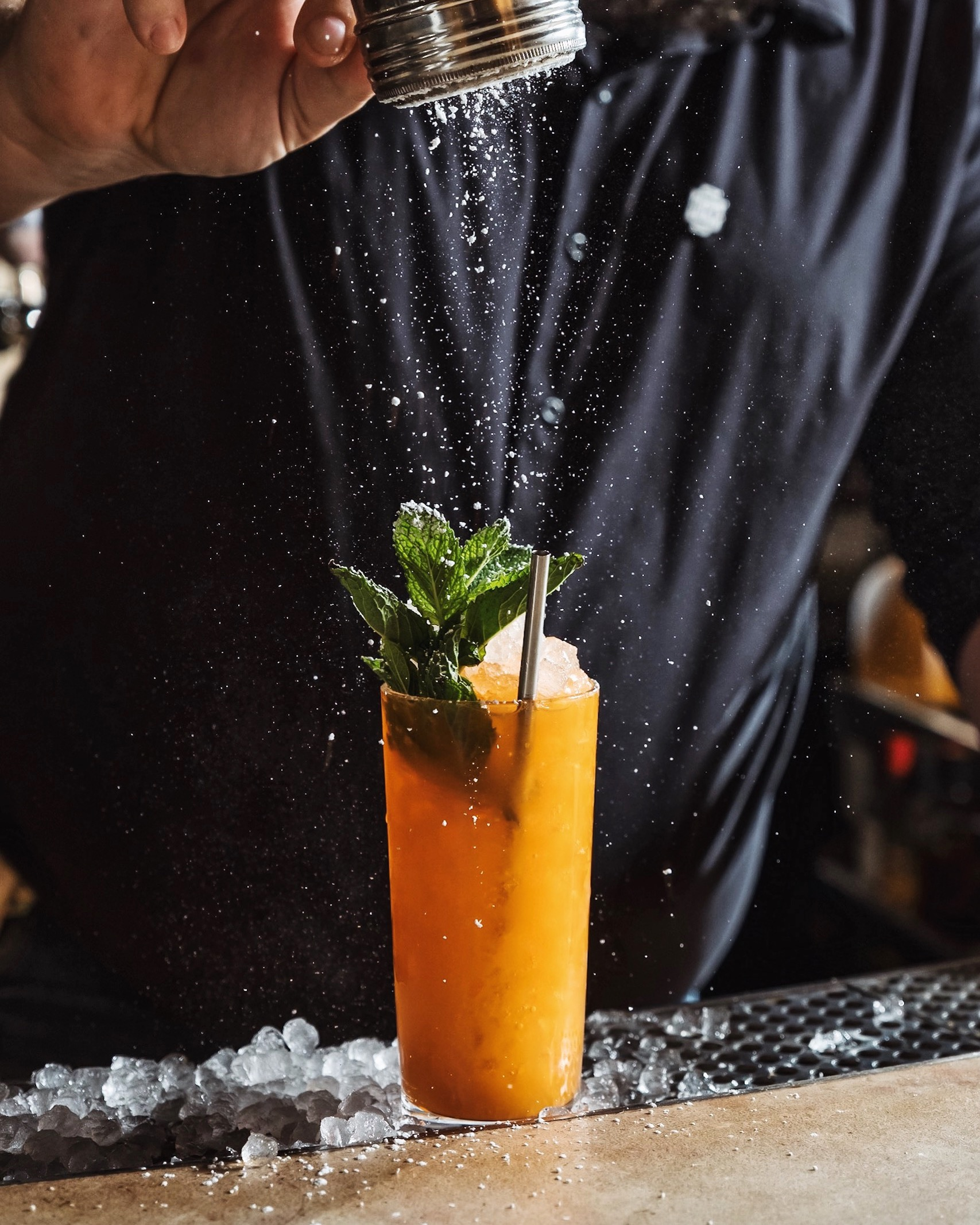 ingredients: - 1 ½ ounces Plymouth Gin¾ ounce carrot juice½ ounce lemon juice½ ounce Verde Momento Thai Chili Mezcal½ ounce mint syrup¼ ounce Velvet Falernum2 drops saline solutionFresh mint and powdered sugar, for garnish