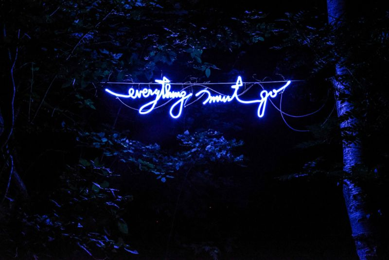 Everything Must Go • Neon sign in woods by the bleachers for Night Swap, 2016.