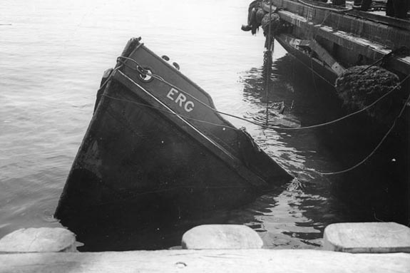 The Erg • The Erg was a boat thrice sunk off the coast of Nova Scotia (1917, 1942, 1942). I created a model of the Erg and floated it for the fourth time in the New Mexico Sky with weather balloons.