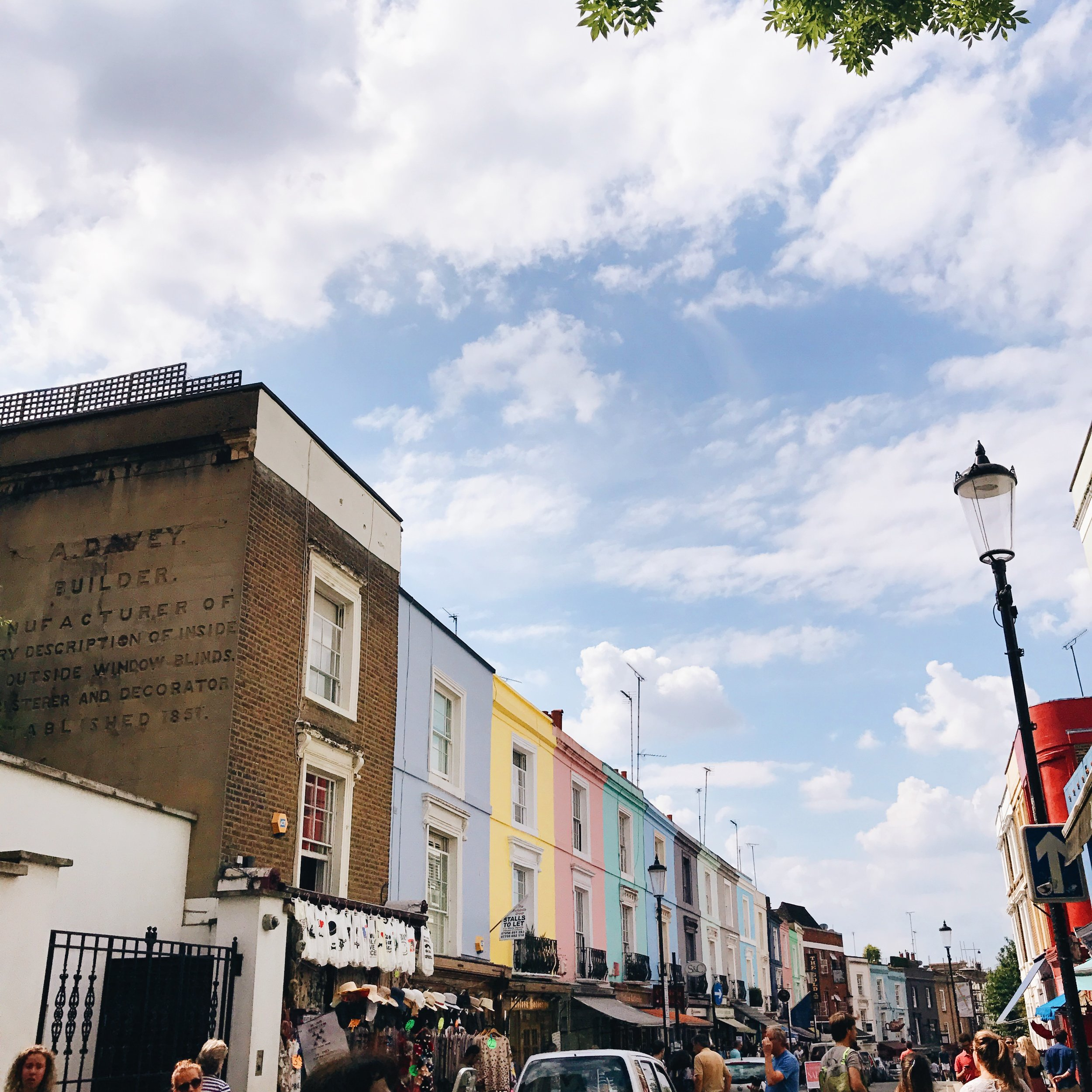 Obviously, we found  Portobello Road and it's market . The day we visited, it was the most beautiful day, and so the whole street was filled with stalls and people, and there was something about the hustle and bustle that really brought the place to life and it was lovely.  After taking hundreds of photos of the colourful houses, we went to find   the blue door   from the movie ( and if you don't know what I'm talking about then I'm not sure we can friends anymore tbh ;)  ). Although, I'm not going to lie... it's literally just a blue door. It's someone's front door and a little underwhelming when you finally find it, haha!  If I had enough money, I would absolutely move to Notting Hill.  It's so pretty, elegant and there's just something about it that made me happy . My aim is get back here soon and spend the whole day there, wandering around again, but also finding some of those amazing places to eat and drink, too!