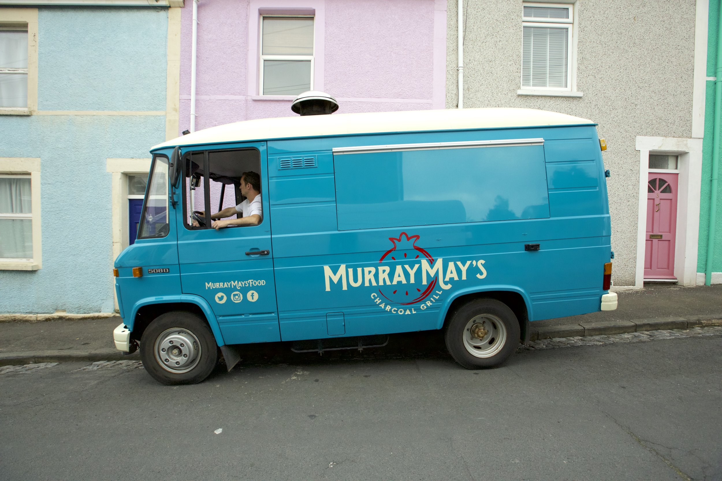 THE VAN - Our van 'Nessie' is a 1987 Mercedes 508D ex-military Dutch ambulance. She is converted (a labour of love!) to an exceptionally high standard. Resprayed in a beautiful blue teal, with a copper bar running the length of the hatch. The centrepiece of the kitchen is the Turkish mangal charcoal grill, we're sure we are the only food van to have one!