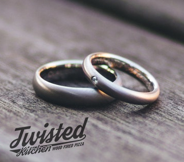 wedding rings on wood WITH LOGO.jpg