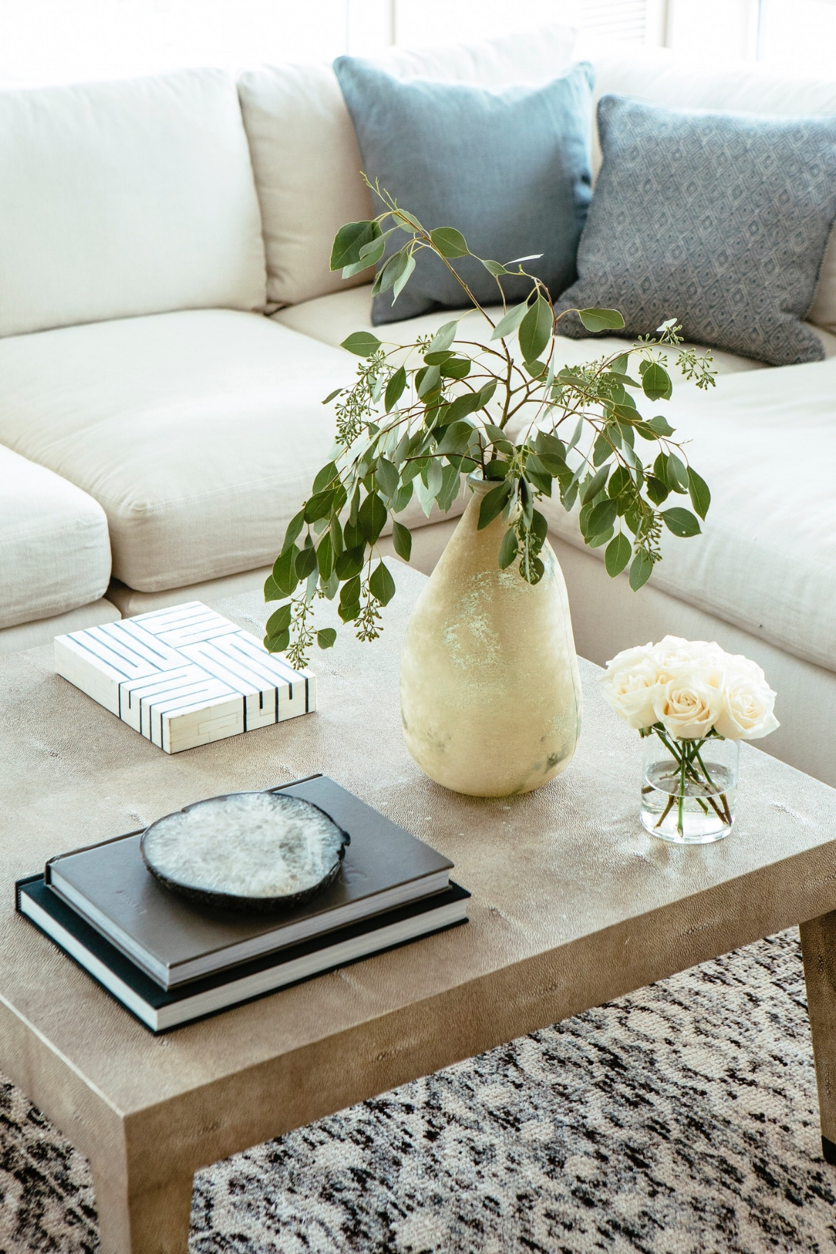3. Natural Neutrals  - In the realm of nature, green is the strongest neutral there is. Adding in greenery in the form of plants, branches, trees, and flowers, will instantly pump up a neutral space and add an extra layer with little effort or money. Not only do natural elements like these bring in their own texture, imperfection, and beauty, but they also introduce an additional color without necessarily coming across as color. When clients have a space that just feels unfinished, I always suggest bringing in natural plant life — and it's always the perfect finishing touch. Image from JBD Chicago Project by Heather Talbert