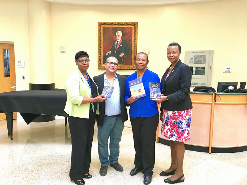 (l to r) Bertha-Mae Walker, PhD, university librarian, University of The Bahamas;Neko Meicholas, publisher Guanima Press Ltd; Patricia Glinton-Meicholas and Linda Davis, PhD, provost, University of The Bahamas.