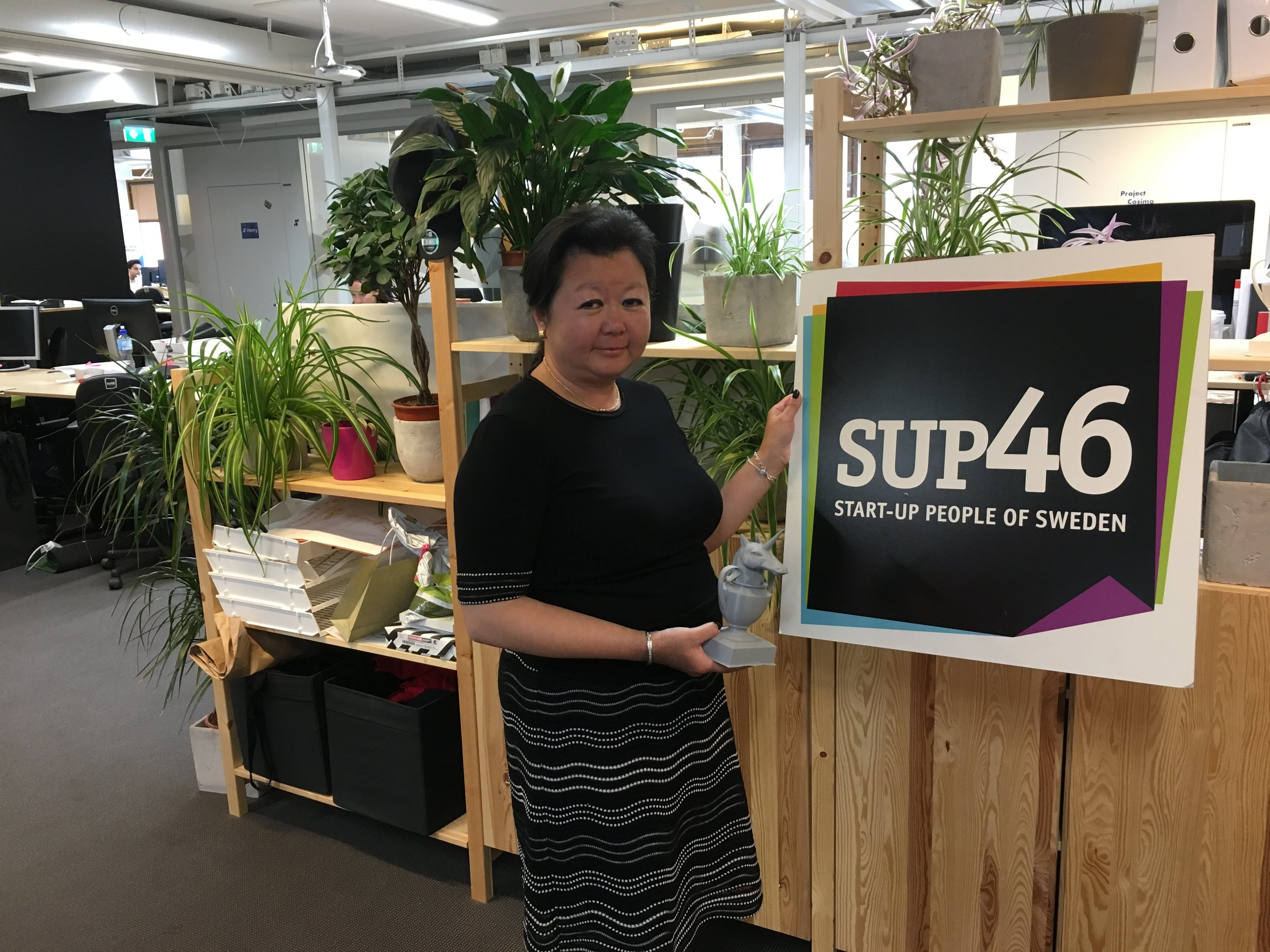 Nathalie with SUP46 sign and 3D-printed Unicorn statue