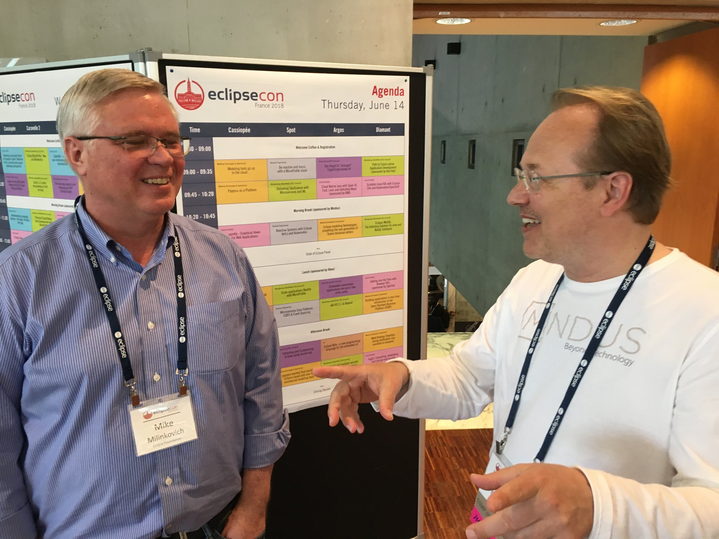Executive Director at Eclipse Foundation Mike Milinkovich with Christopher Mindus discussing the EclipseCon event