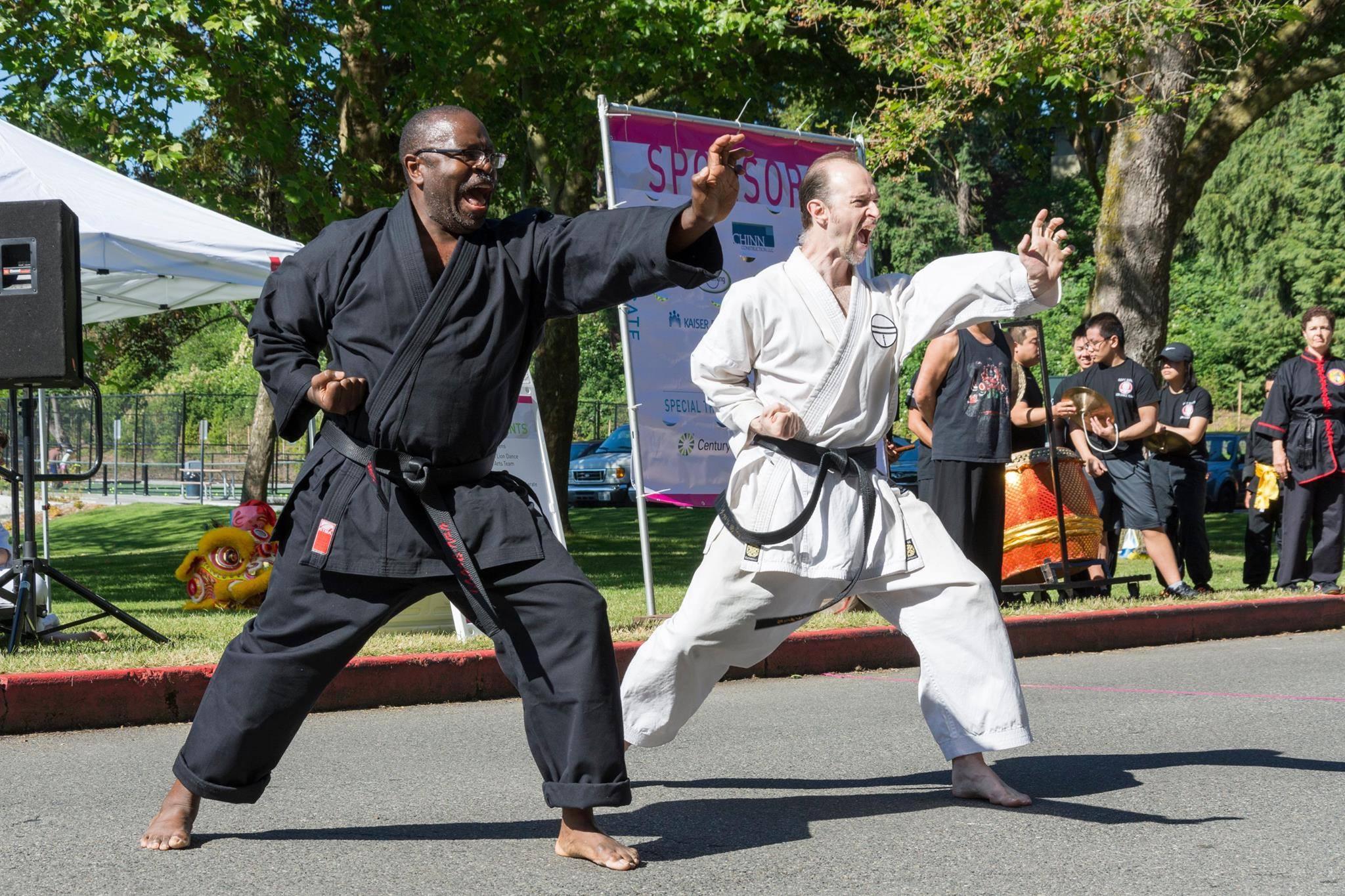 Founder sensei Jackson (left), doing synchronized Paiku with sensei Herivel at the Walk for Rice, 2017.