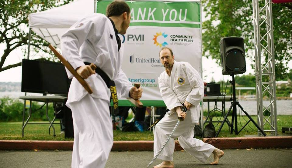 Bryan Rodriguez (left) doing a fight demo with sensei Greg Sommers-Herivel.