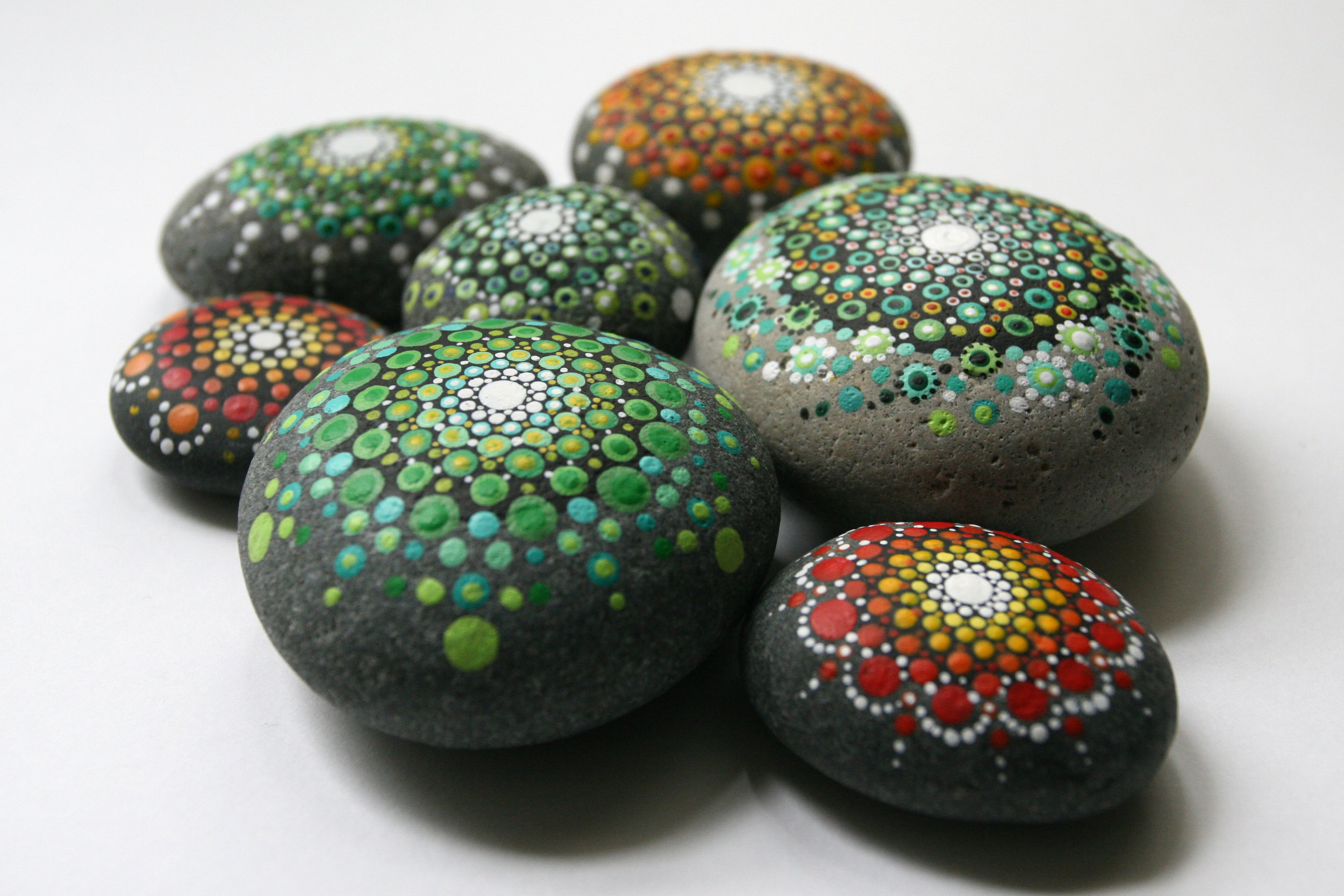 Colorful hand painted dot mandala stones by Casey Grenier