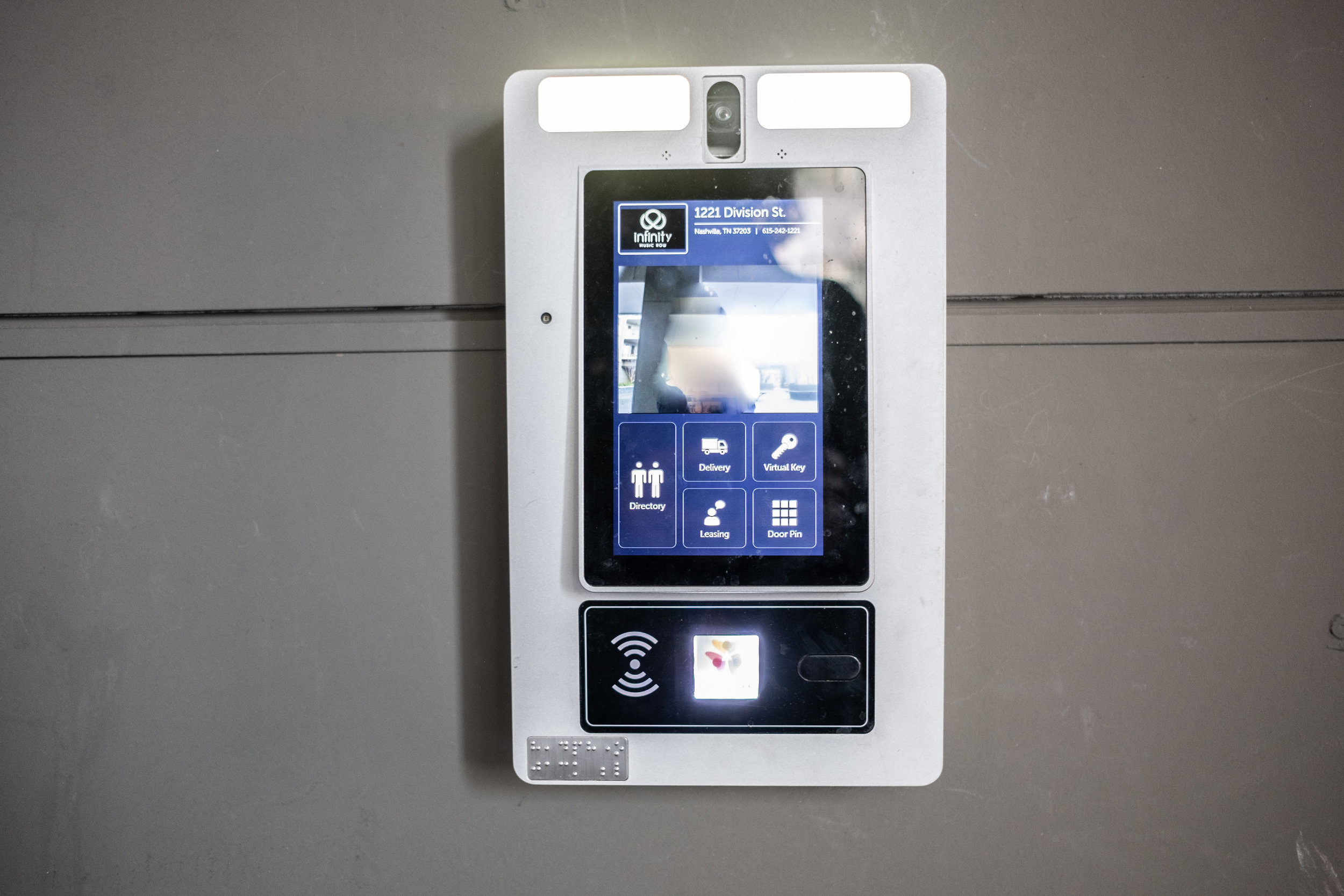 Touchscreen to enter building entrance.