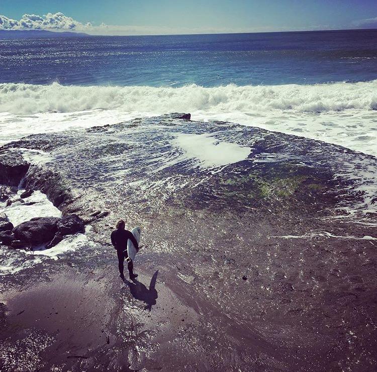 surfer on rocks.jpg