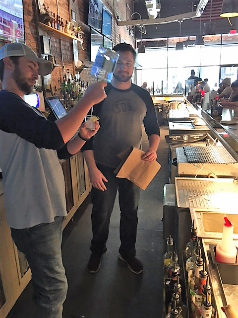 Trey the new Bar Manager for Statesboro being coached by Wilmington's bartender, Andrew.