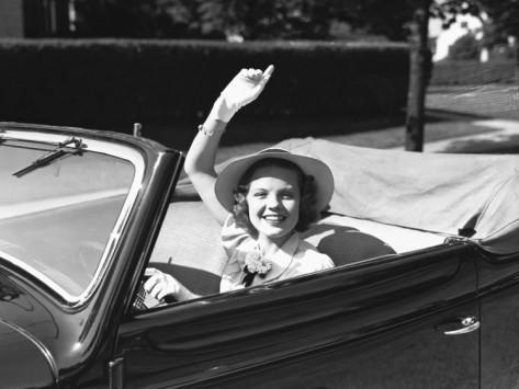 george-marks-elegant-woman-in-convertible-car-waving-portrait-2.jpg