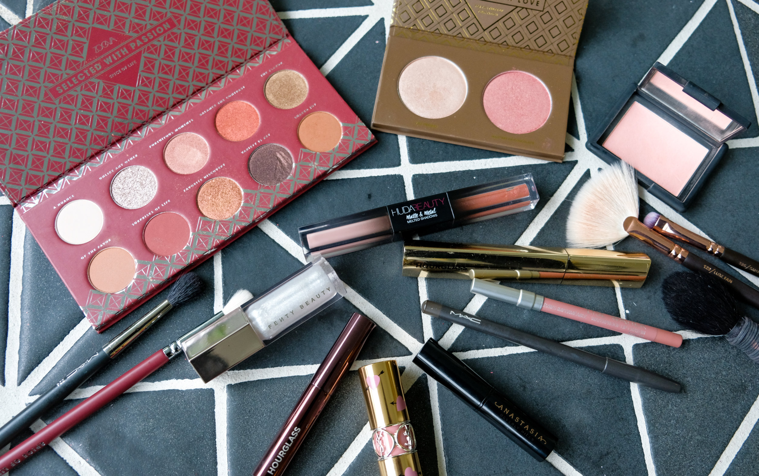 I called up my makeup artist, Nikki and we discussed how to put together a makeup look that isn't so typical for Valentine's Day. My husband hates a red lip, so we're going to keep it soft and glamorous with a few new products.