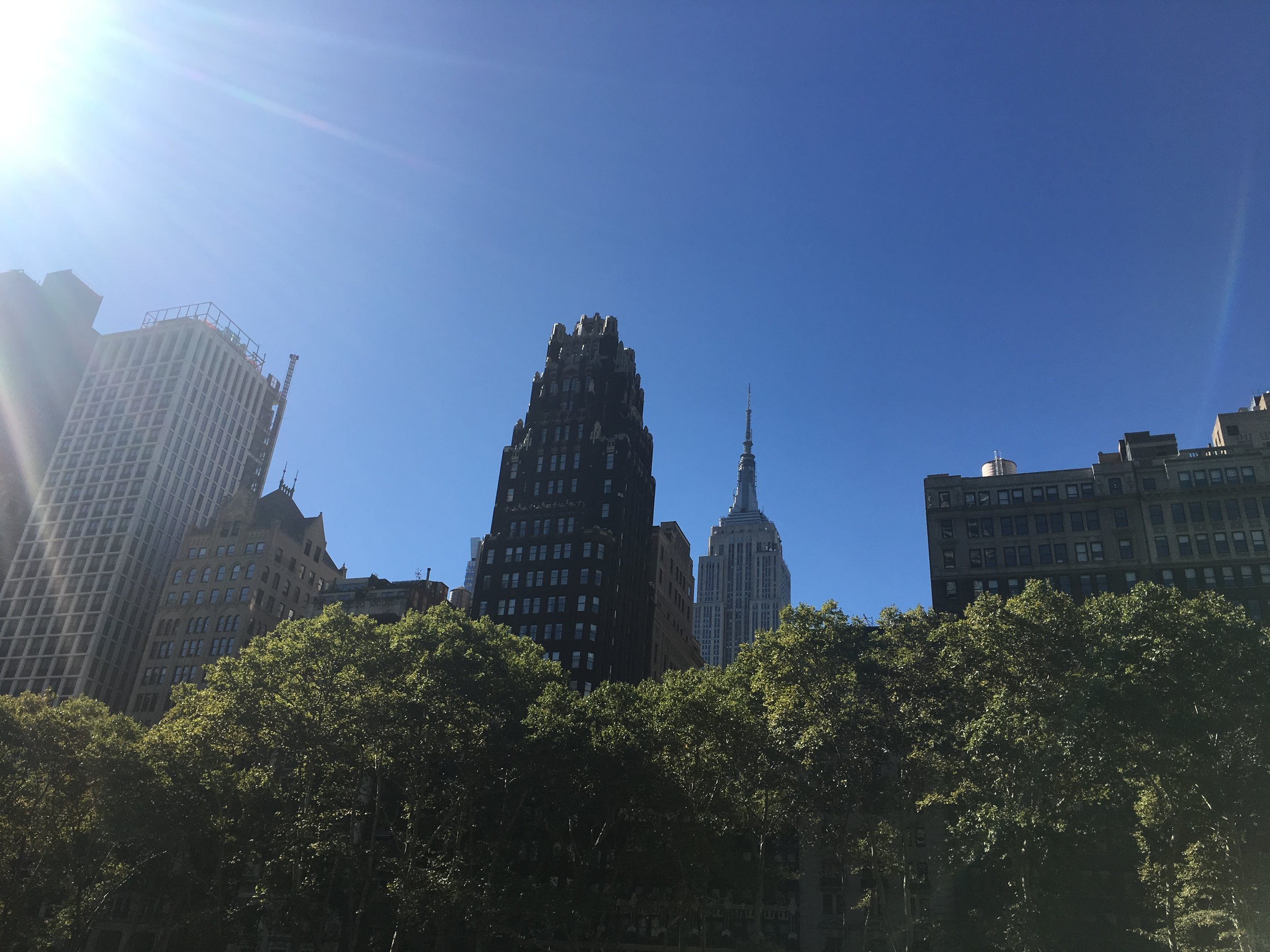 A glimpse of the Empire State building on a sunny day in New York.
