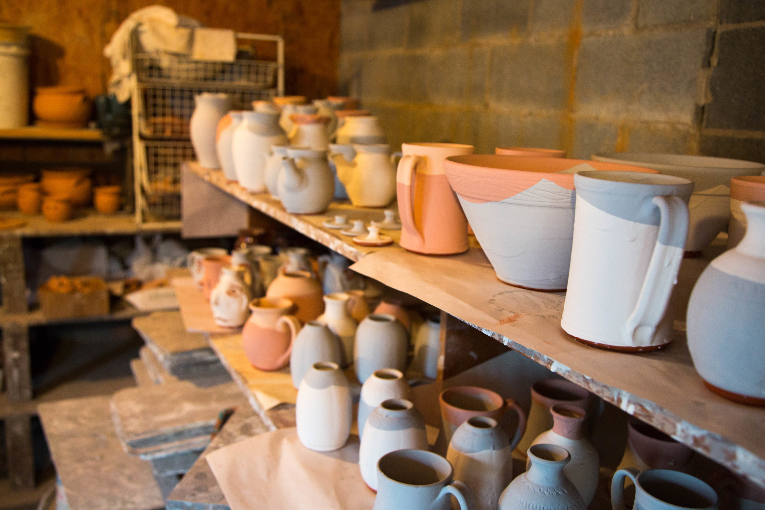 Glazed pots wait to be fired in Glenn and Lula Bolick's workshop.