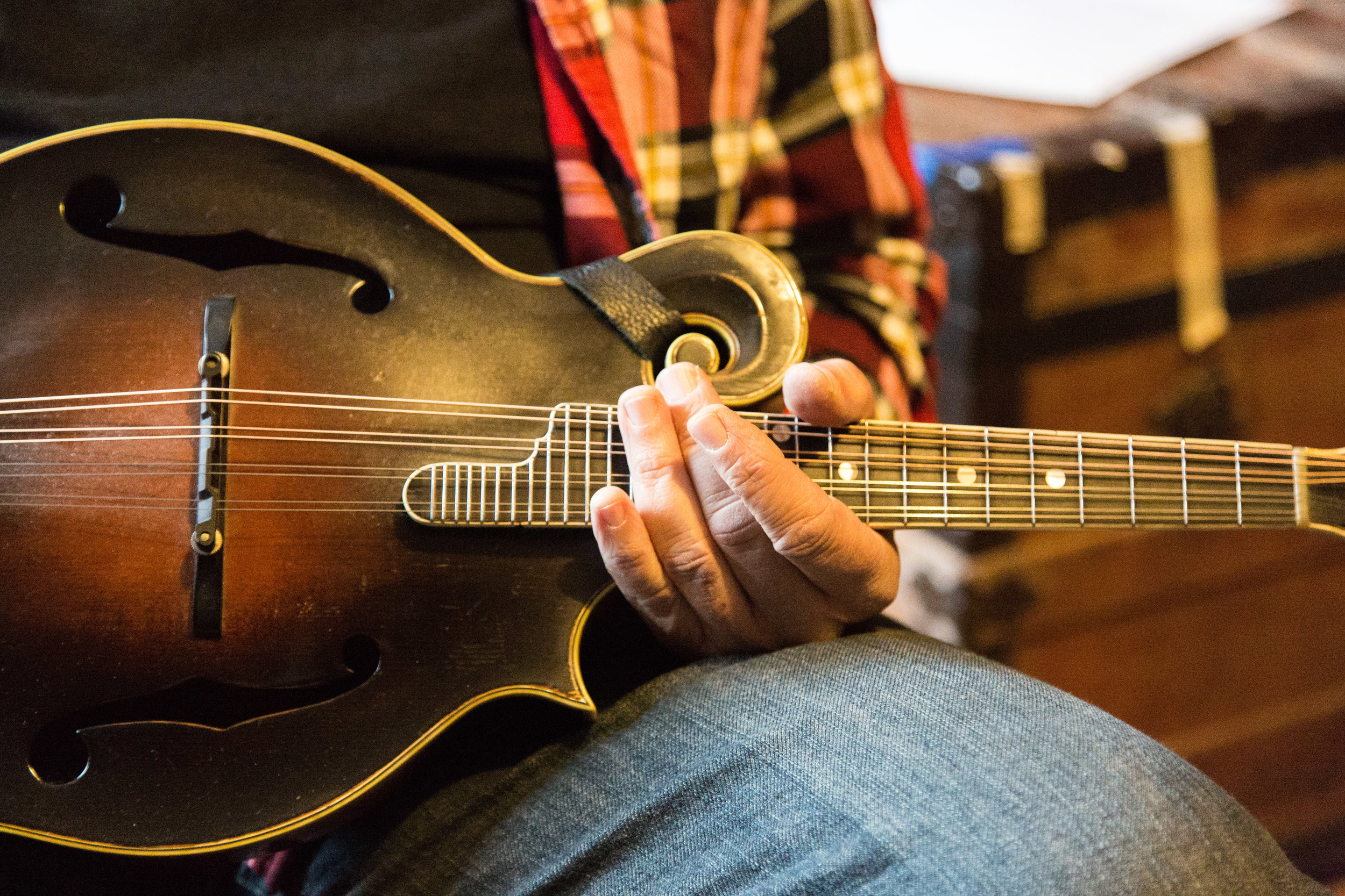 Tony holds one of his beloved mandolins.