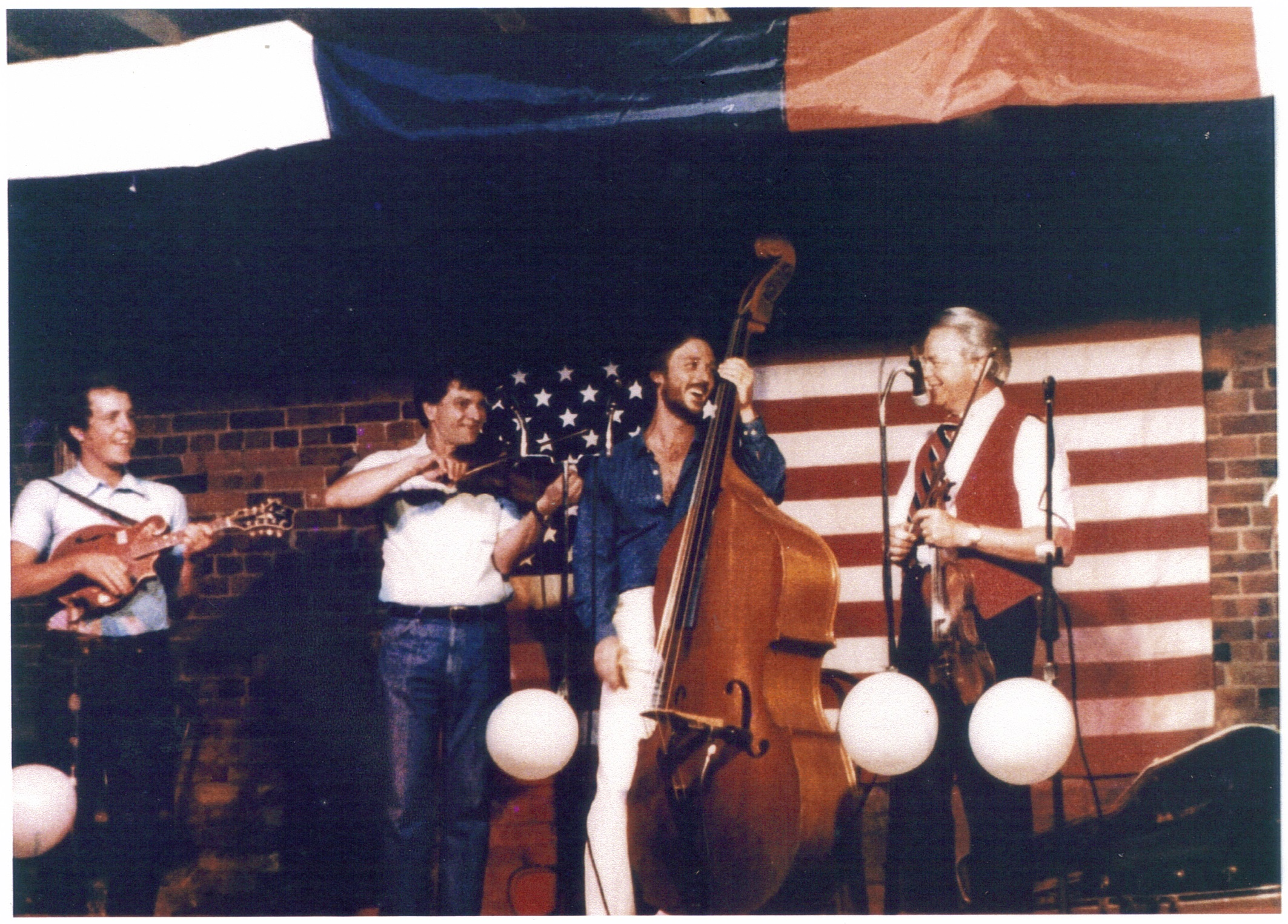 Arvil Freeman, second from left, playing fiddle with former Senator Robert Byrd, far right.