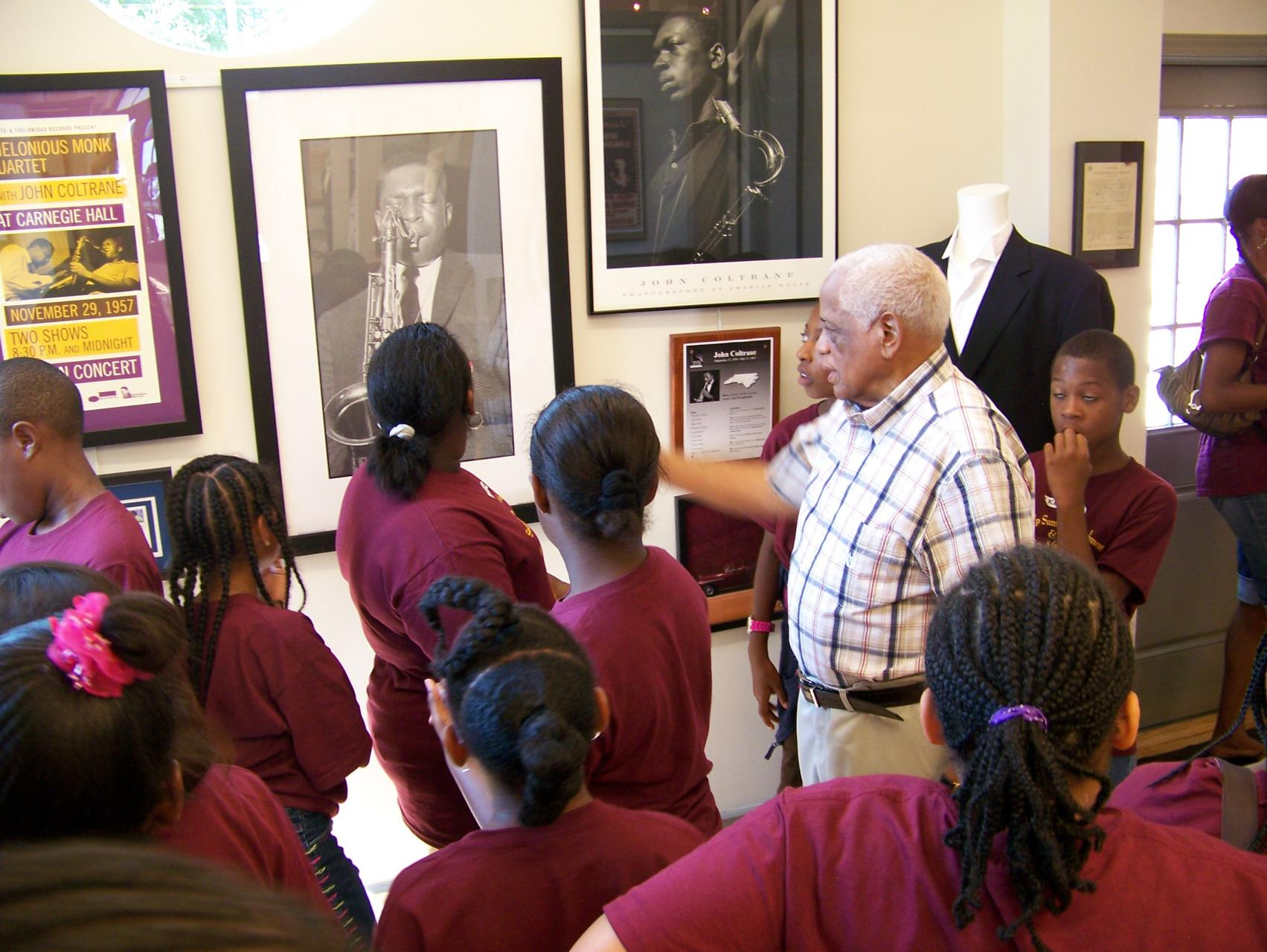 Eddie Ray showing students around the NC Music Hall of Fame.