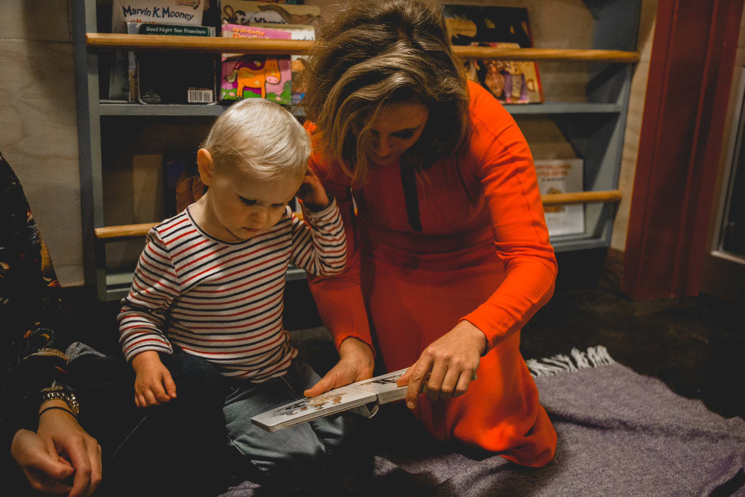 Tift Merritt pauses to read her daugther Jean a book while on tour for the Oxford American's North Carolina Music Issue. December 2018. Photo by Sandra Davidson