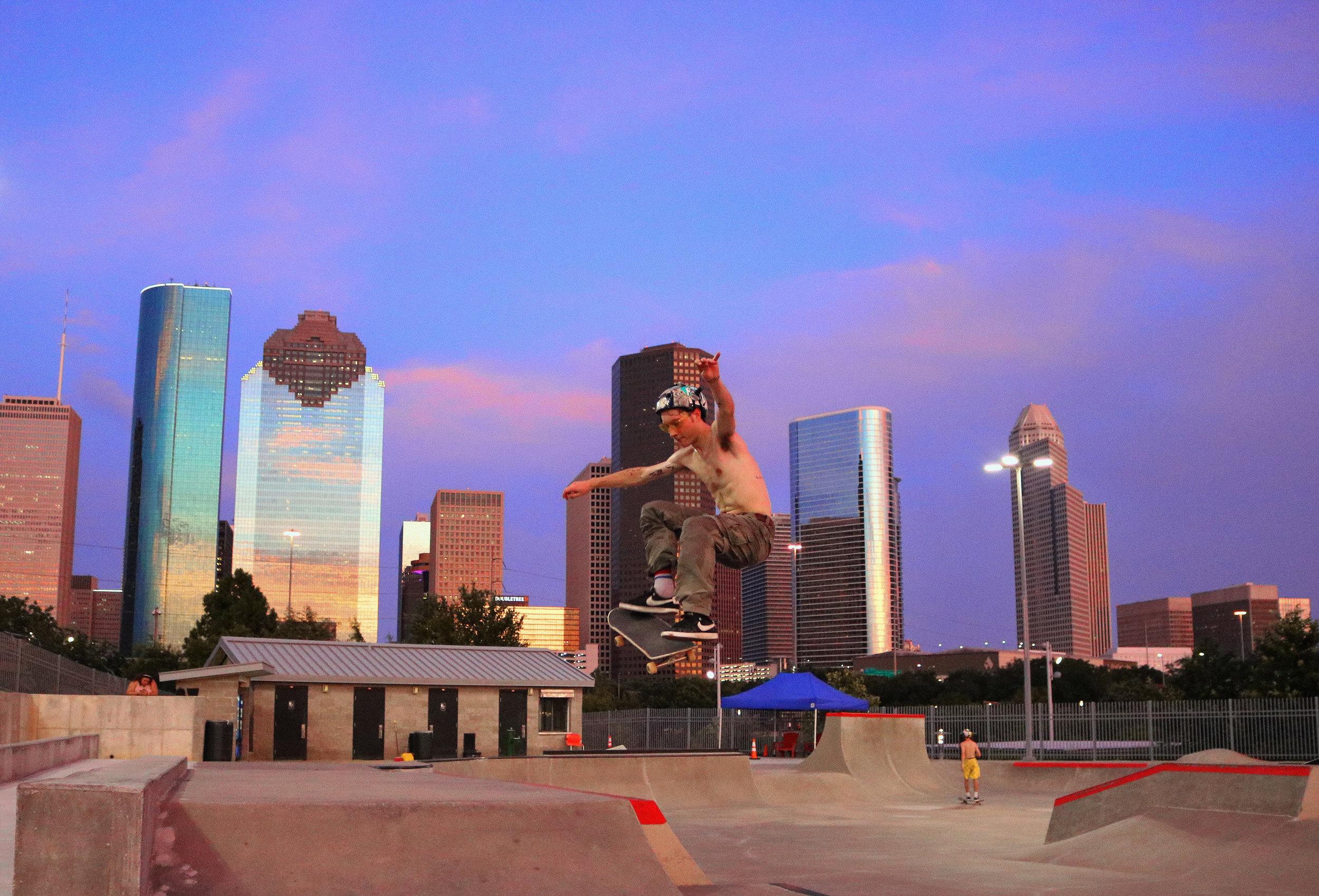 Rob Deutschman in front of the Houston skyline.