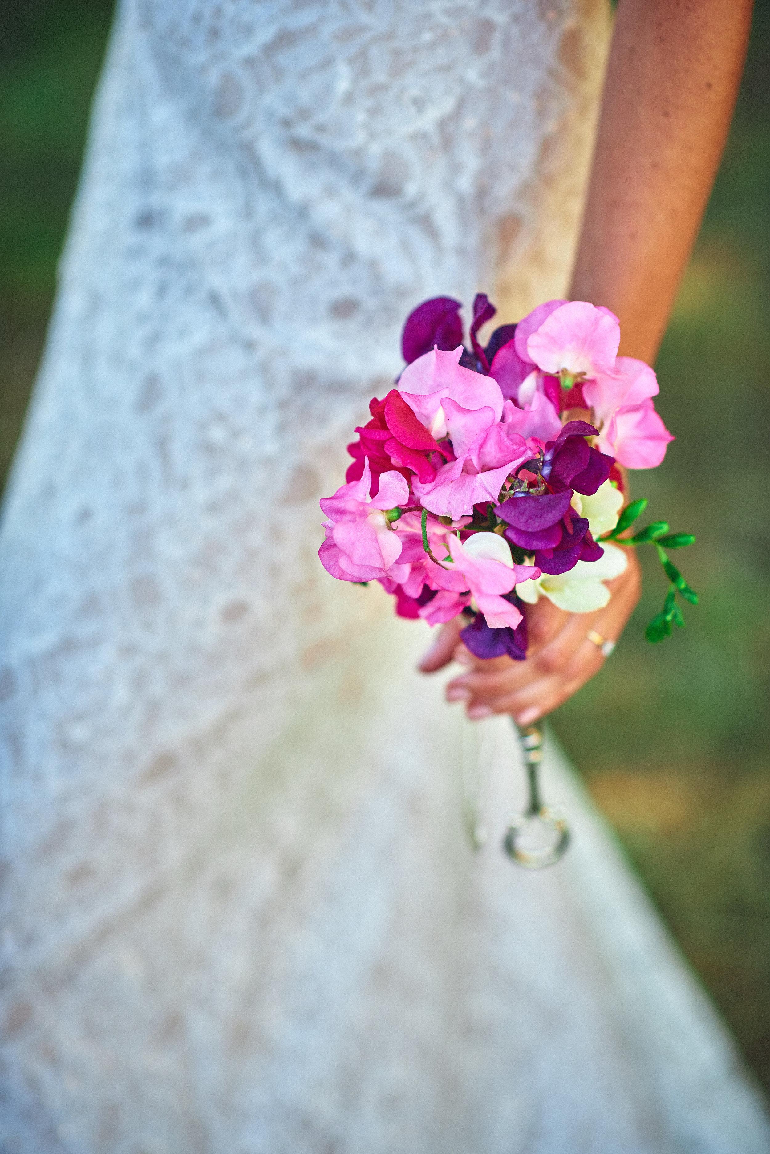 local pea flowers and handmade dress at plum nelli farm wedding.jpg
