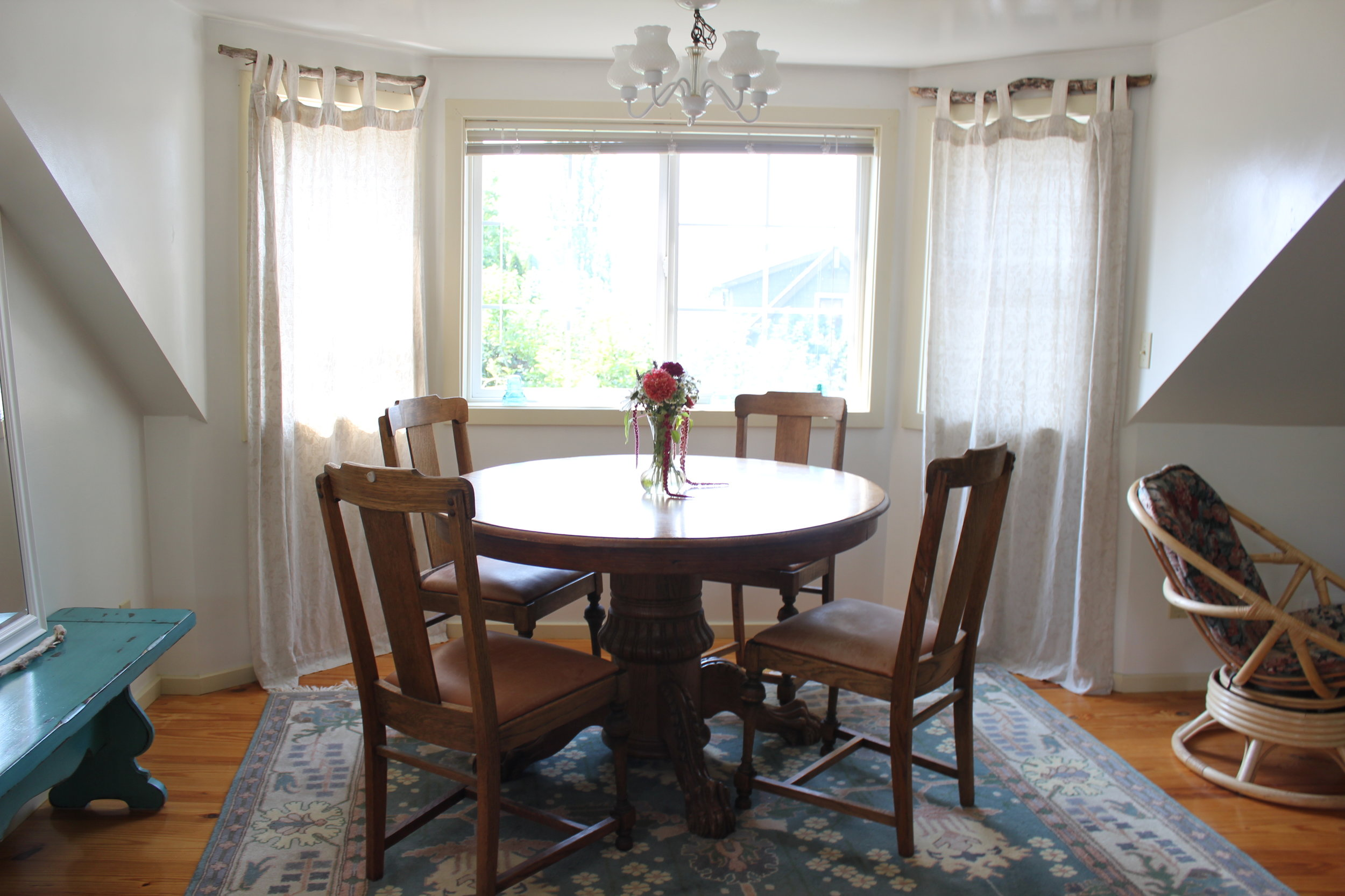 light filled dining room at plum nelli apartment airbnb.JPG