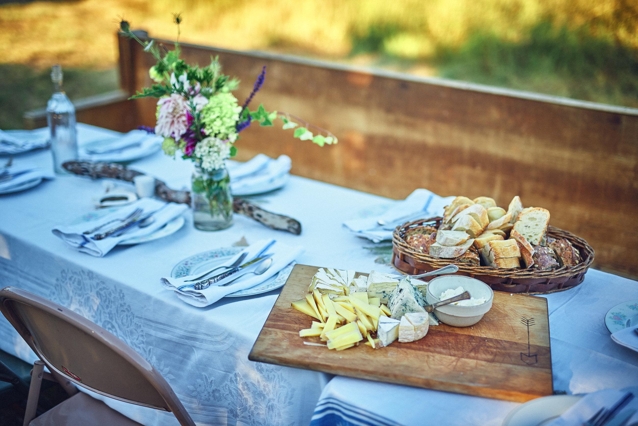 table setting bread and cheese church pew at plum nelli farm wedding.jpg