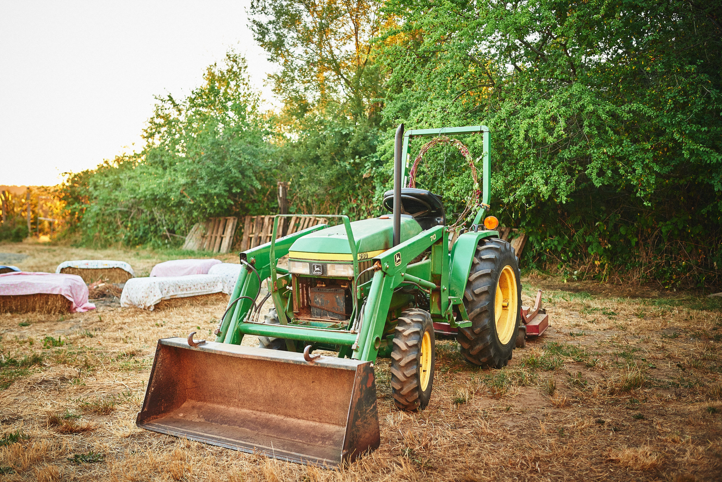 plum nelli outdoor farm wedding haybales and tractor.jpg