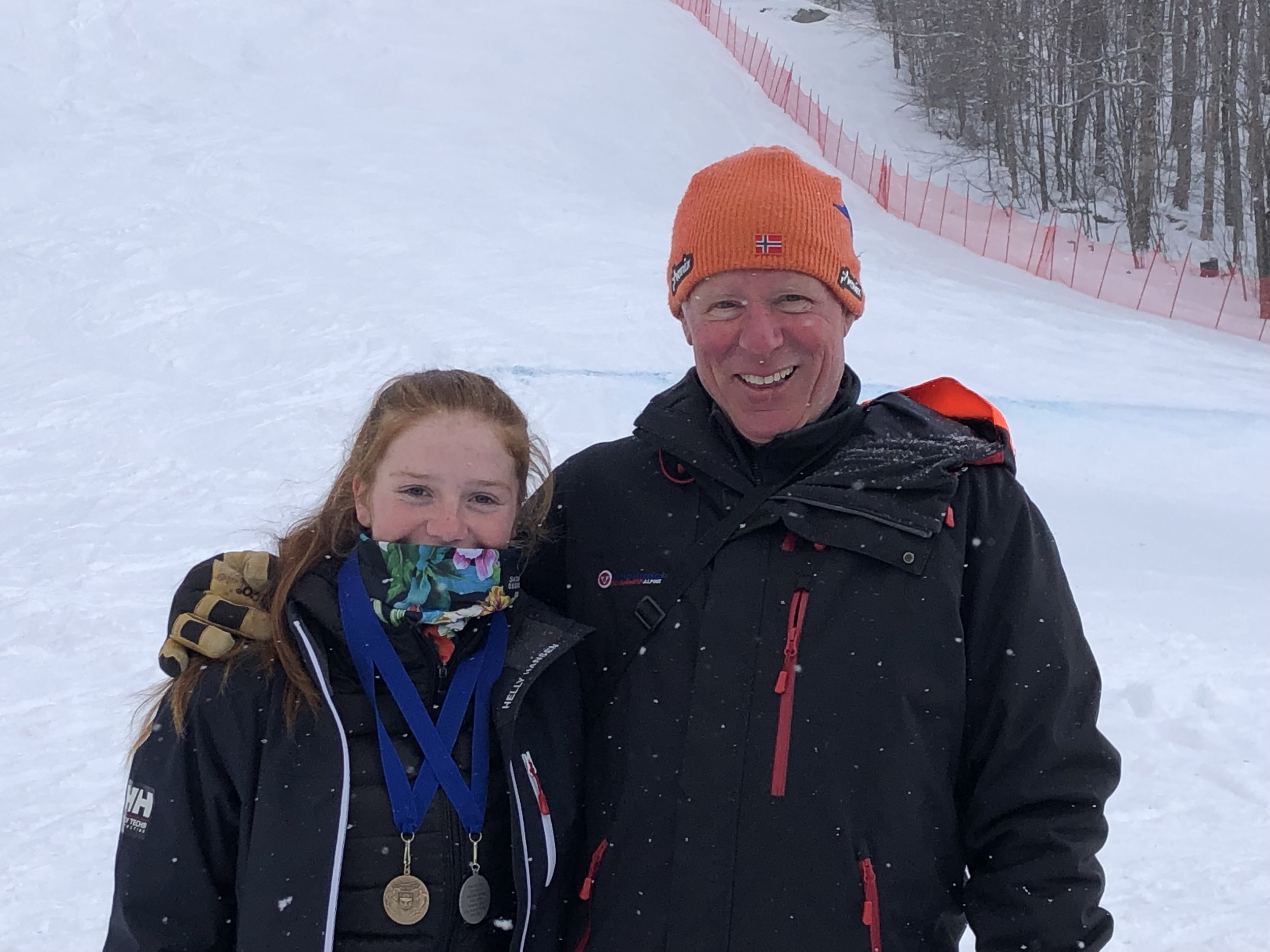 Above: Kelly Gebhardt celebrates with Ski Runners U16/19 Head Coach Scott Smith. Title photo: Kelly Gebhardt, second from left, on the podium today at Pico Ski Club.