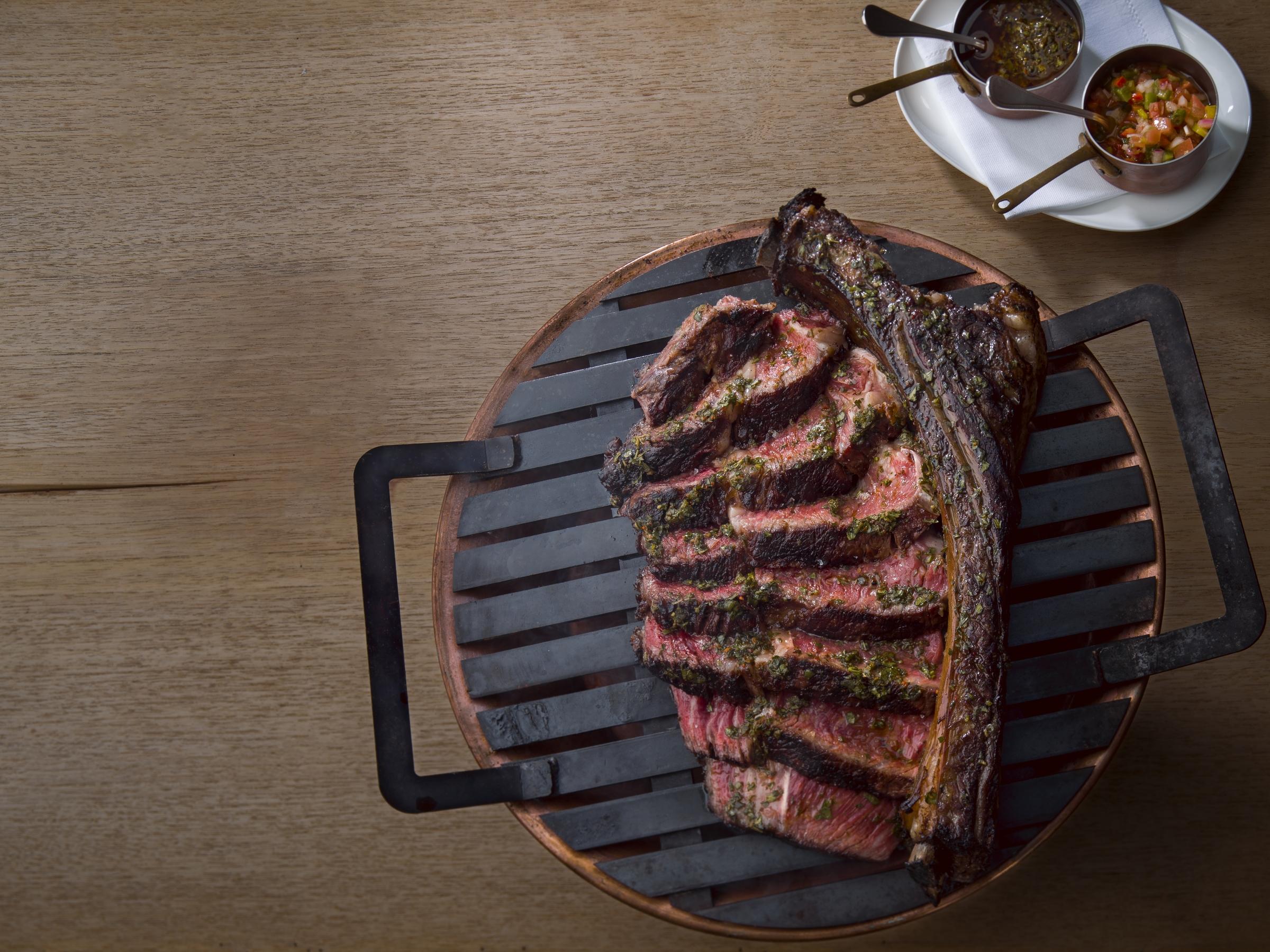 Los Fuegos_oz. 'Hanging' Tomahawk Steak_Photo by Juan Fernando Ayora.jpg