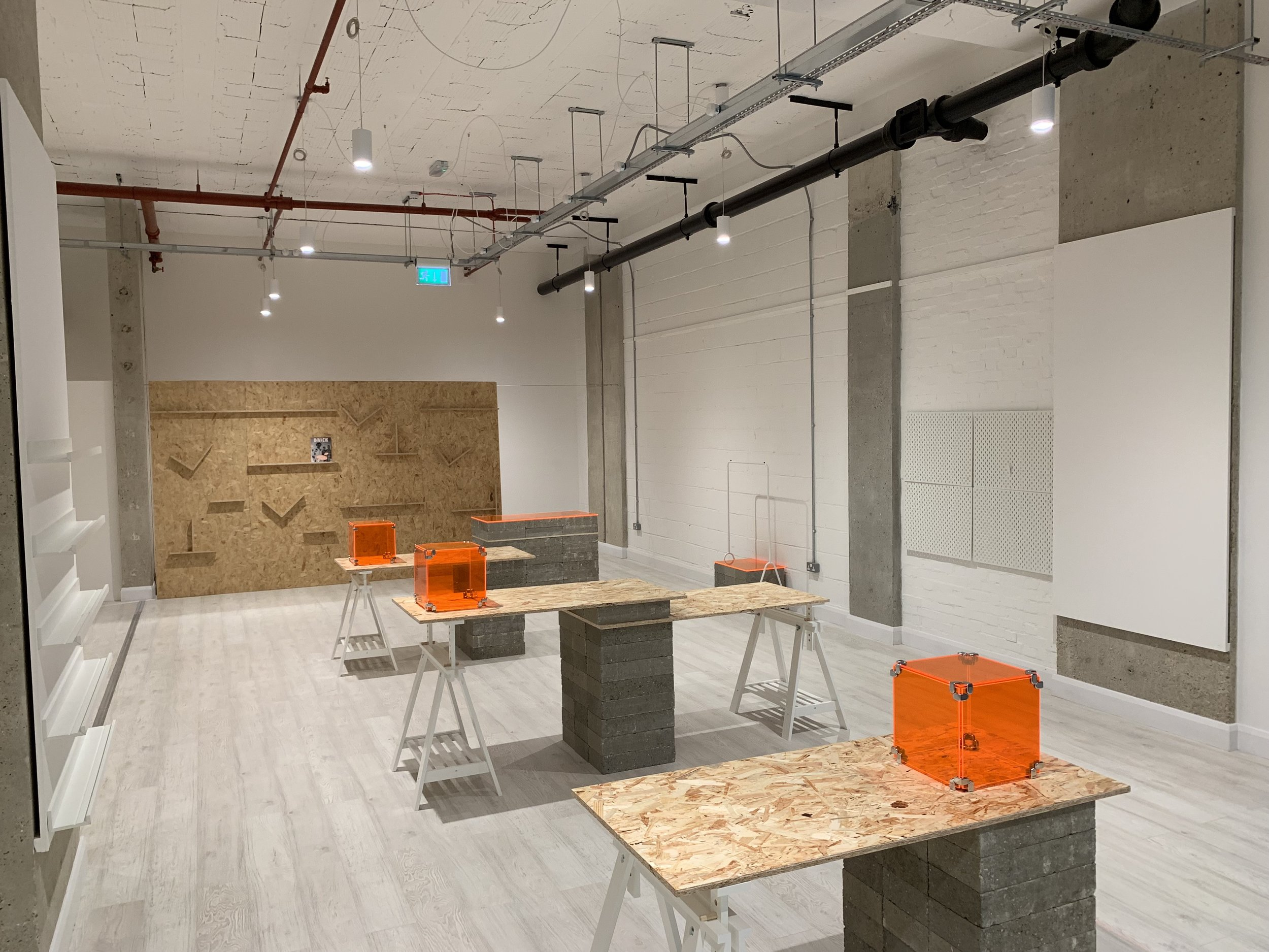 The aesthetic of the build was achieved with a simple palette of materials: OSB, acrylic and breeze blocks with the fluorescent orange acrylic mirroring the brands colours.