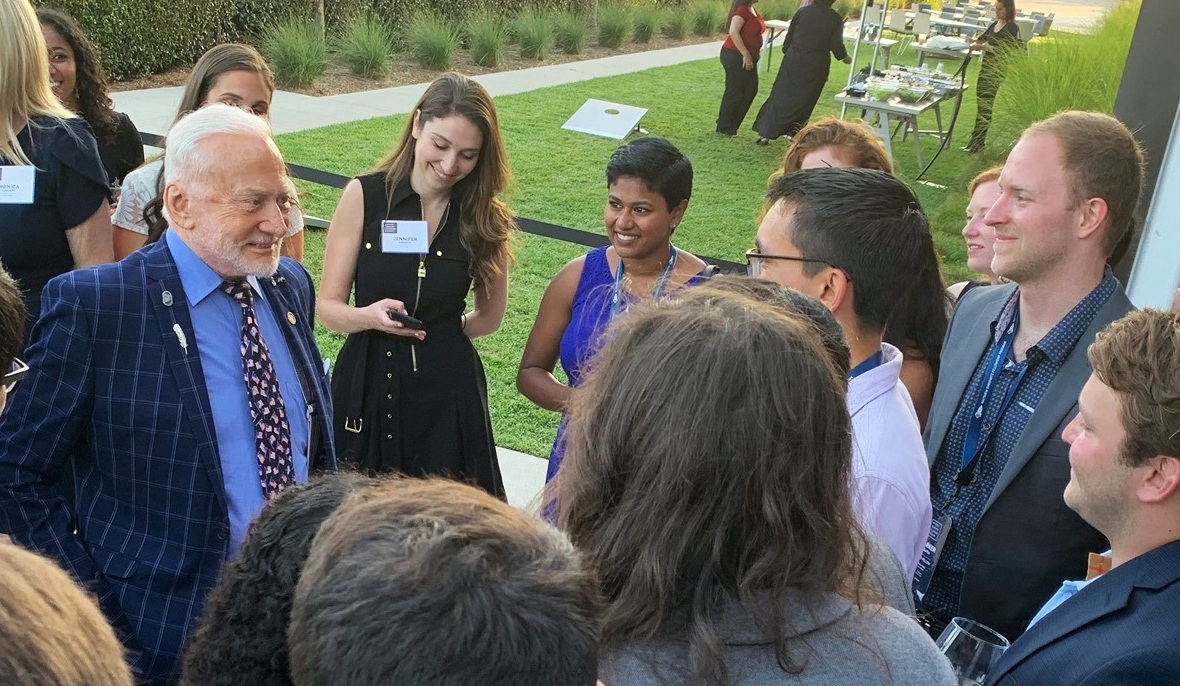 Fellows chatting with Buzz Aldrin, a special guest at the 2019 MIFP Reception & Dinner.
