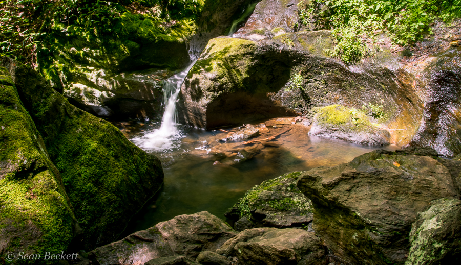 A small waterfall in a pothole of Miller Brook up near the top of Nebraska Notch in the Mt Mansfield State Forest.