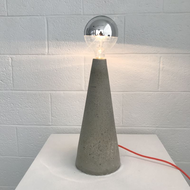 Tall Cone Light by Nicholas Tilma.  Each Cone Light is concrete, hand-cast in a plastic cone - creating a sense of forward movement and new meaning to familiar symbolism.