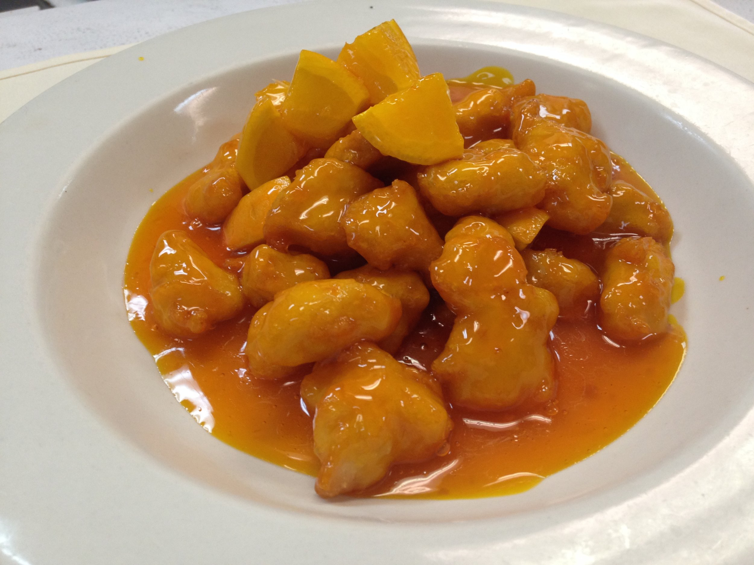 orange chicken - Marinated fried chicken in orange juice, topped with fresh orange, served with rice  7.25 / 10.95