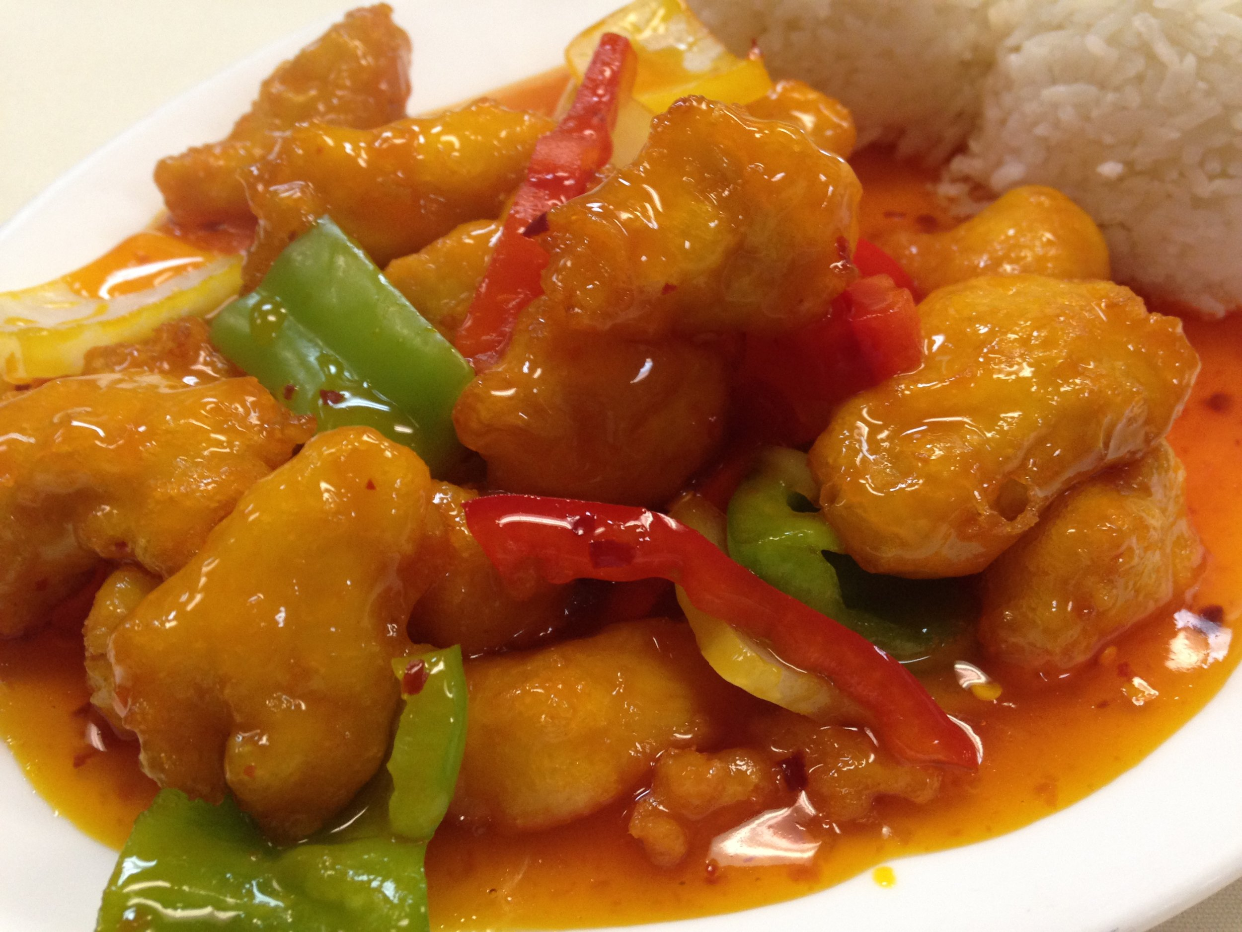 sweet and sour chicken - Marinated fried chicken with pineapple, onion and bell pepper, served with rice  7.25 / 10.95
