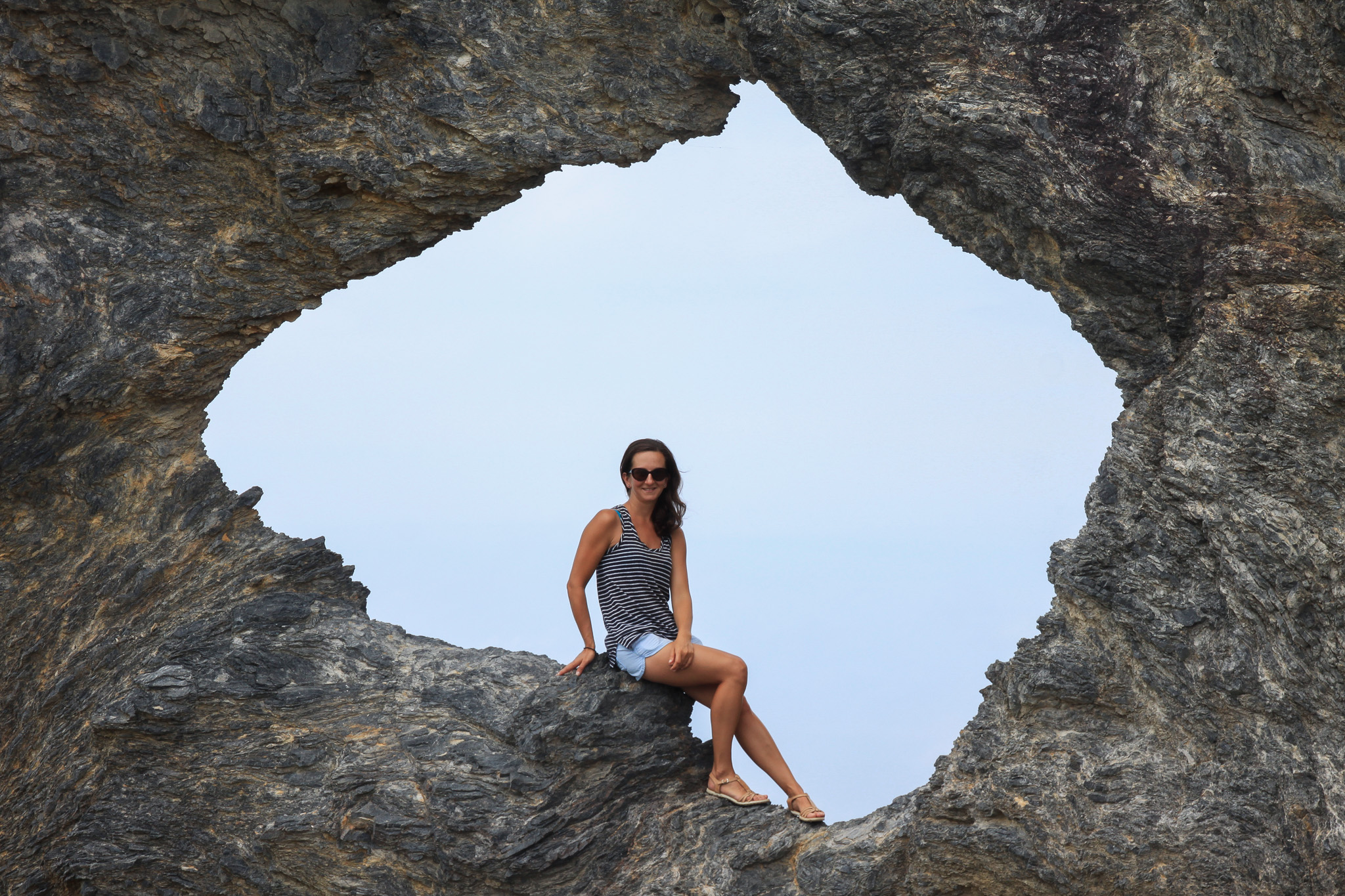 Female sitting in Australia shaped rock