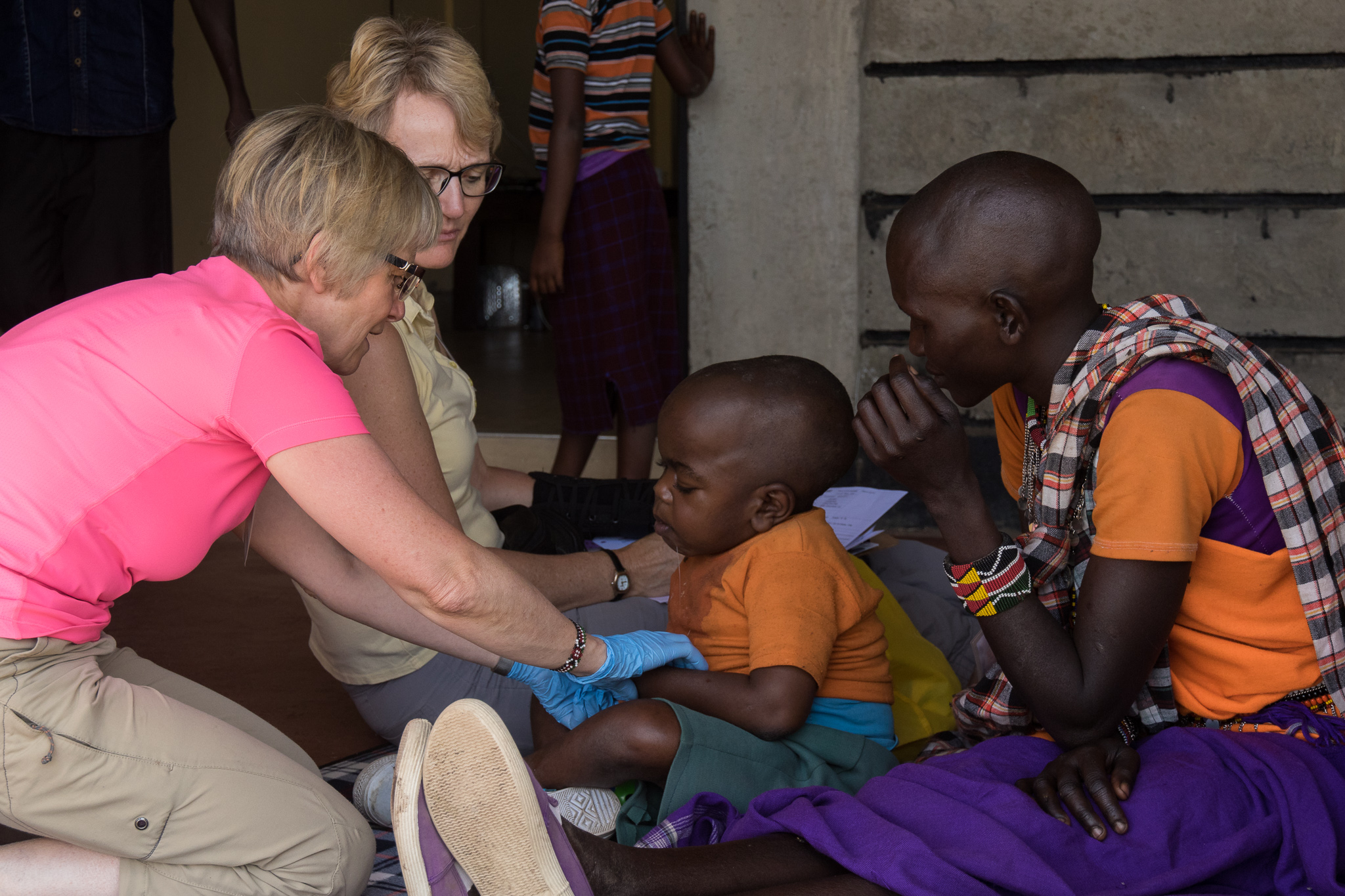 Physical therapist working with disabled child in Kenya