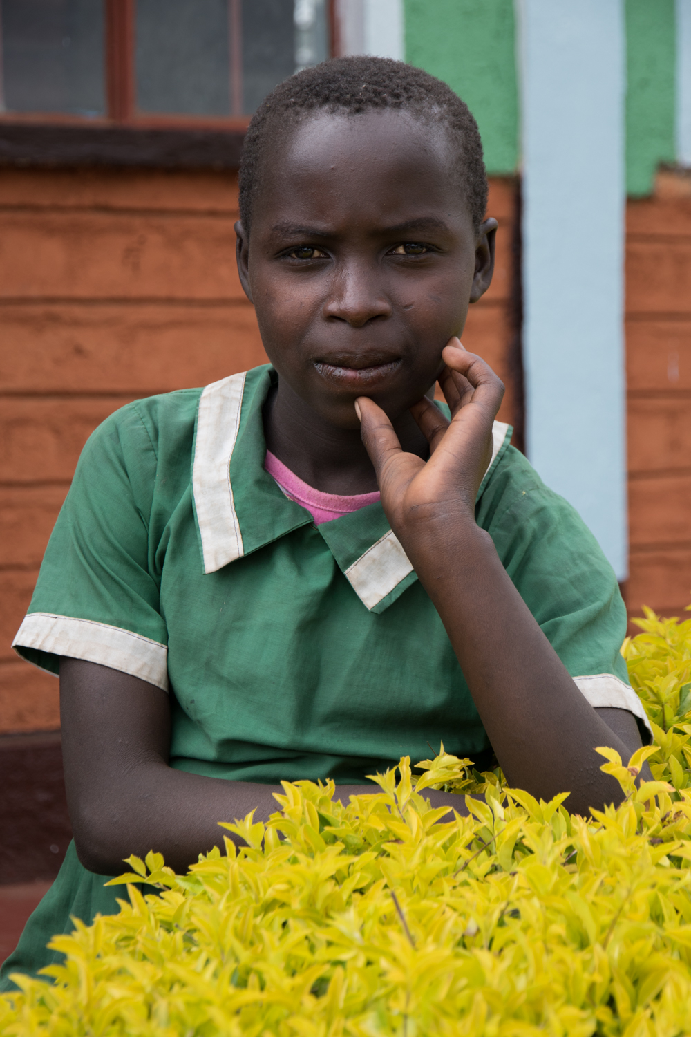 kenyan female student portrait with flowers