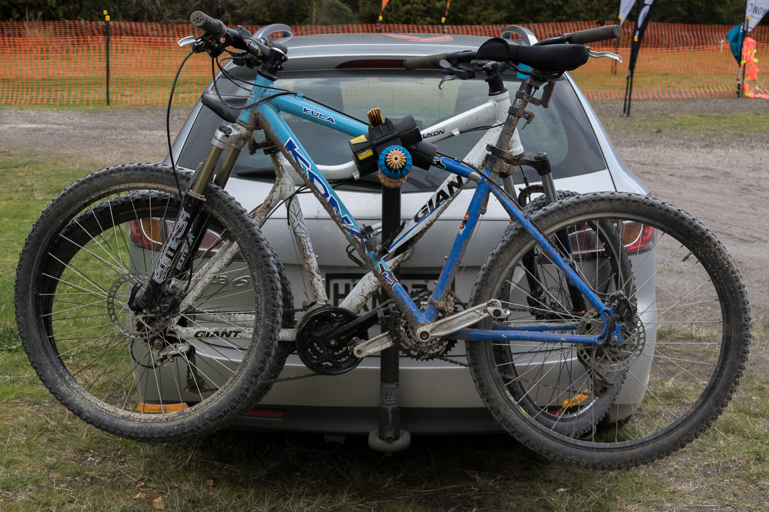 mountain bikes on the back of a car