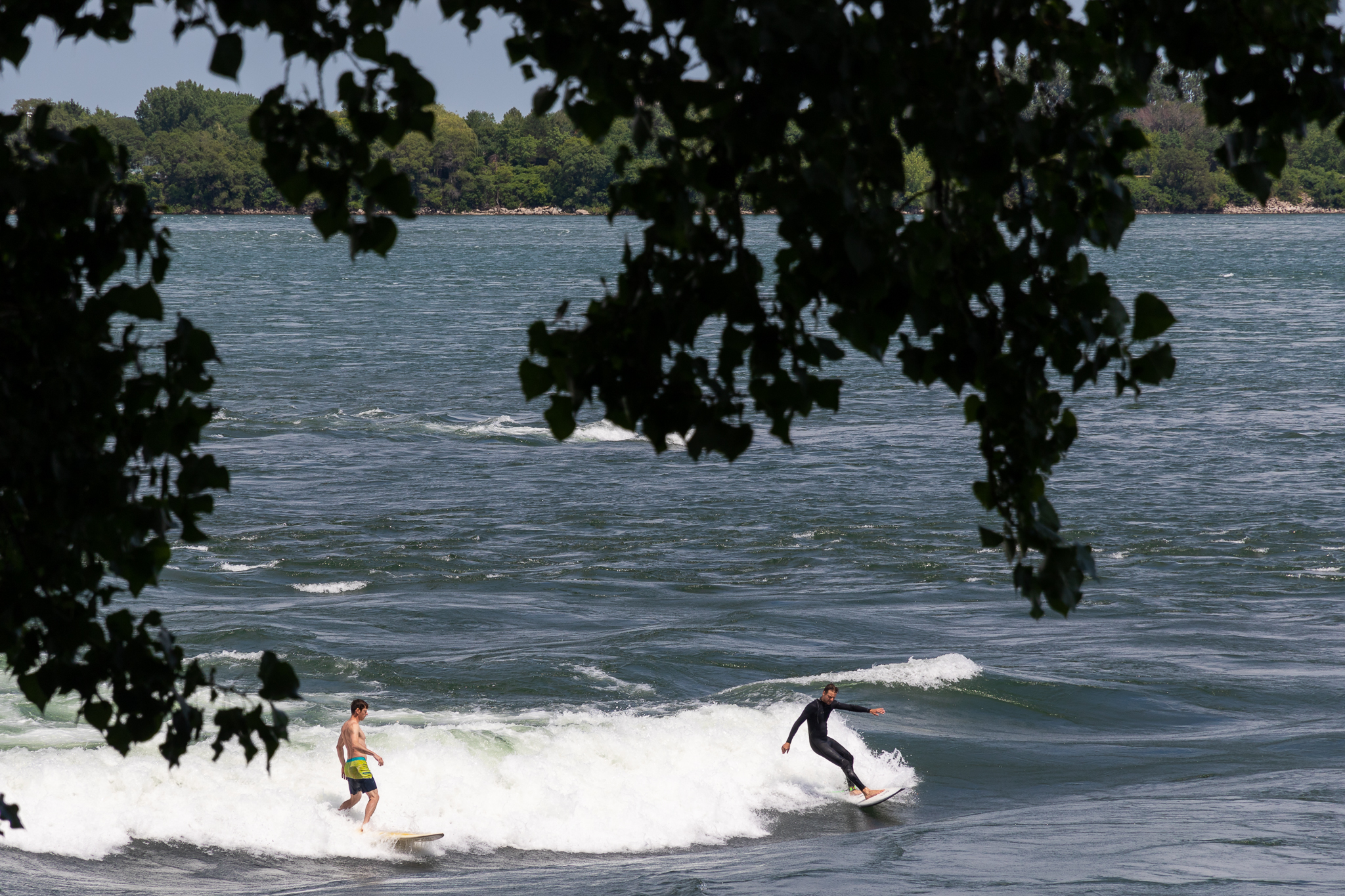 two male surfers surfing at habitat 67 in montreal canada