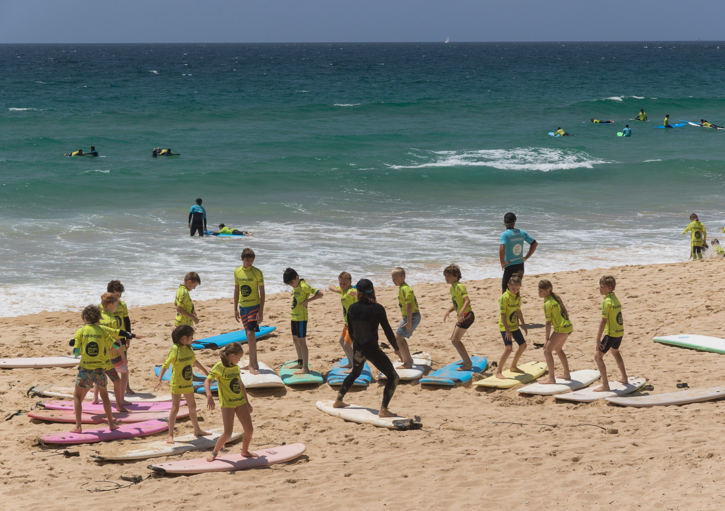 new surfers learning the surf stance on sand