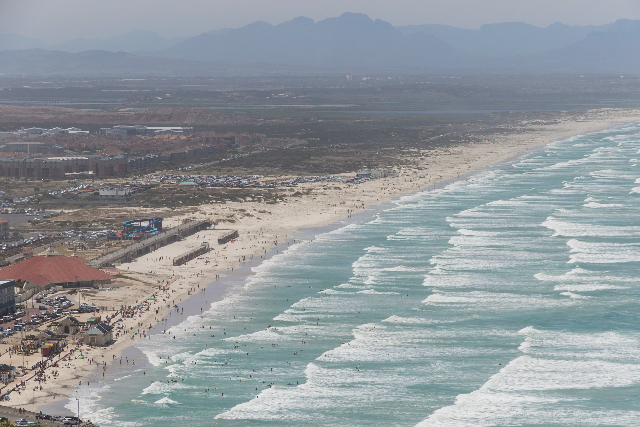 surf waves from a beach in south africa viewed from above