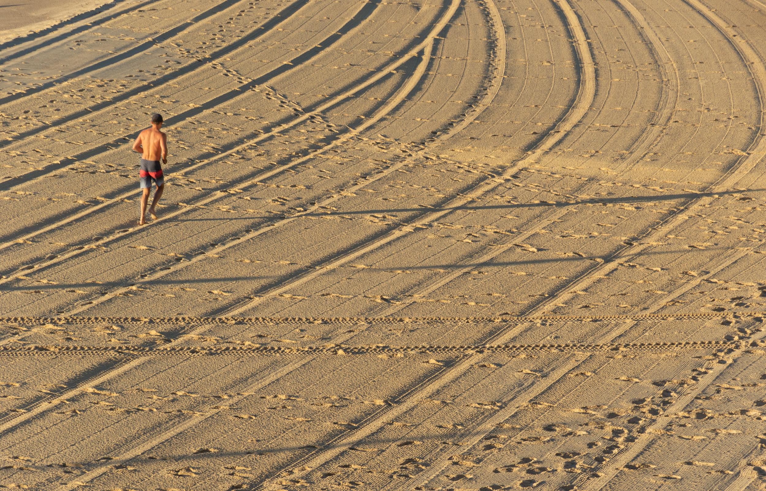 morning runner on the beach