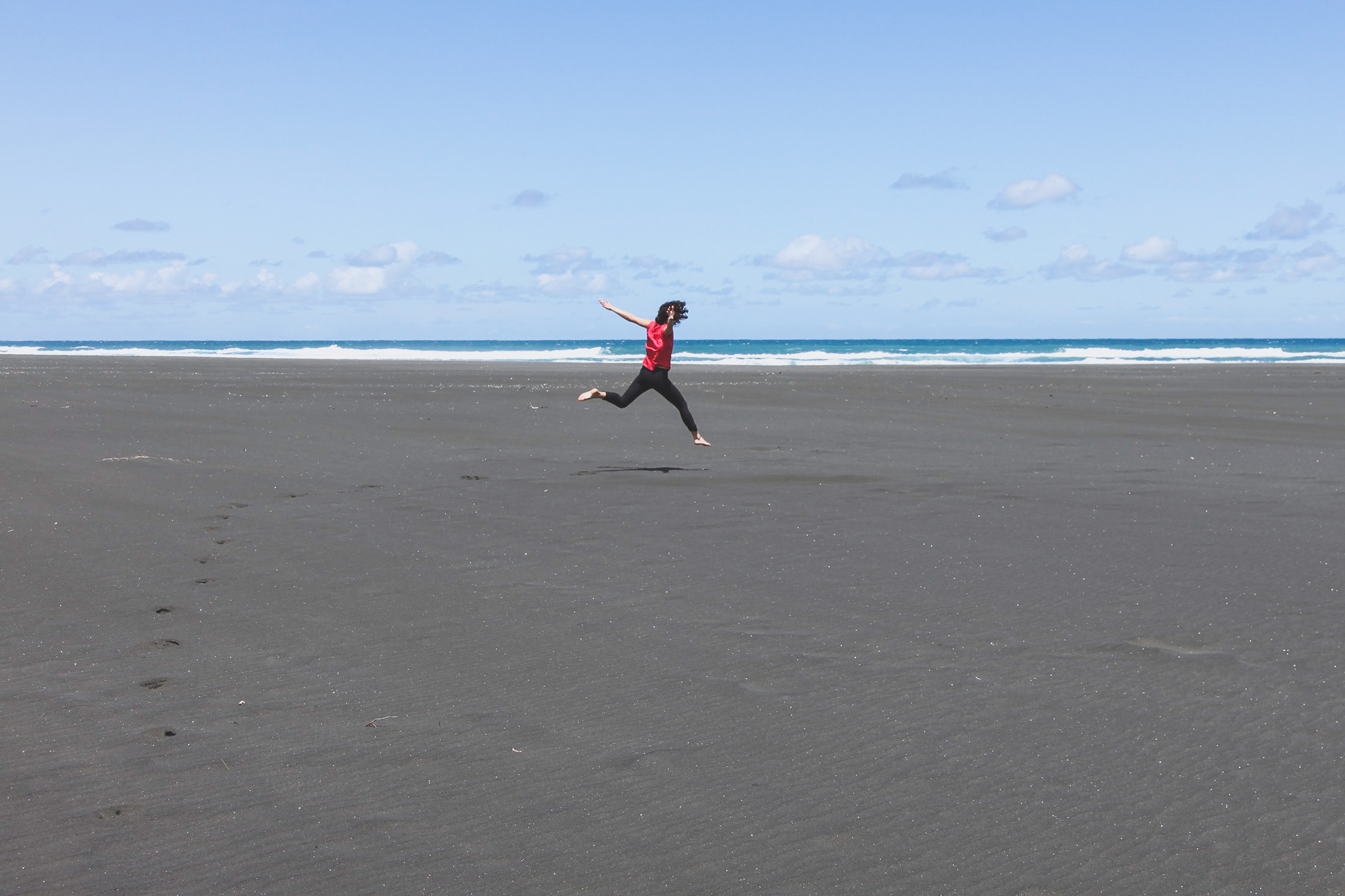 exploring the black sand beaches in auckland